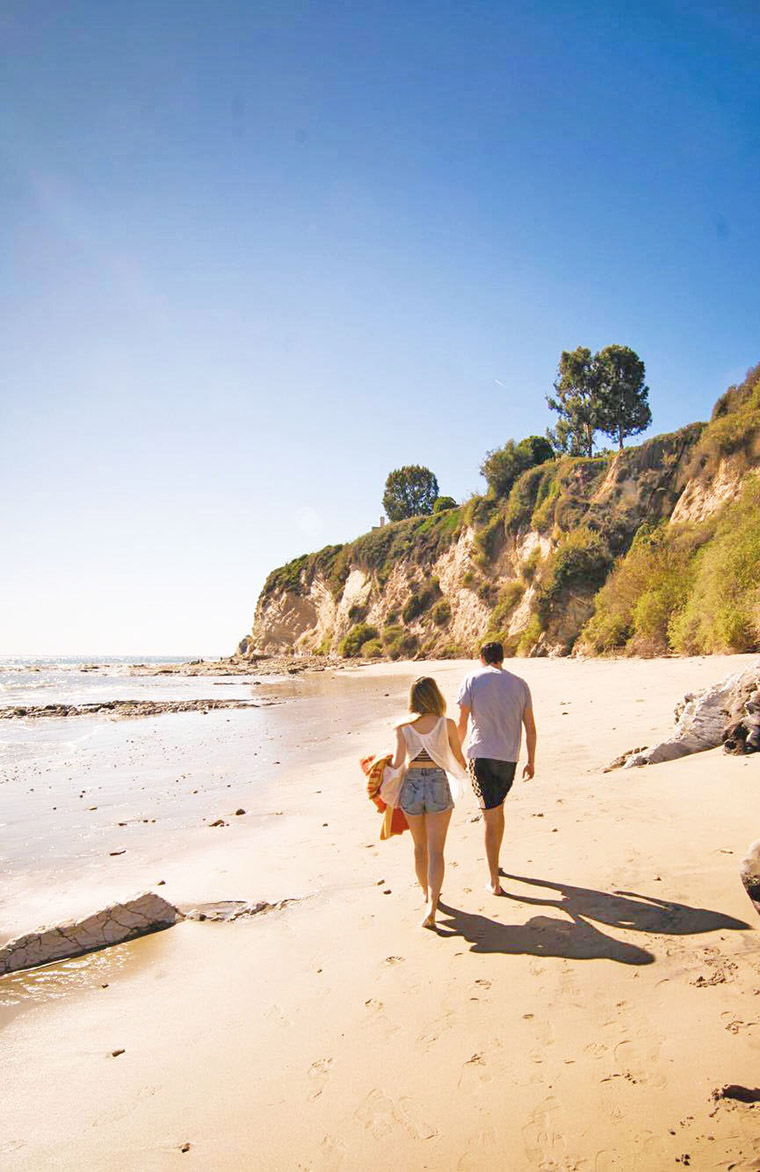 walking on the beach together in malibu california