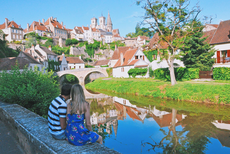 sitting and looking at bridge in small french town Semur en auxois