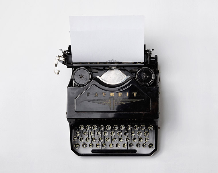 typewriter ready for a travelogue to be written