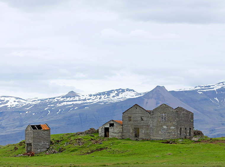 abandoned house on hill in iceland view from ring road