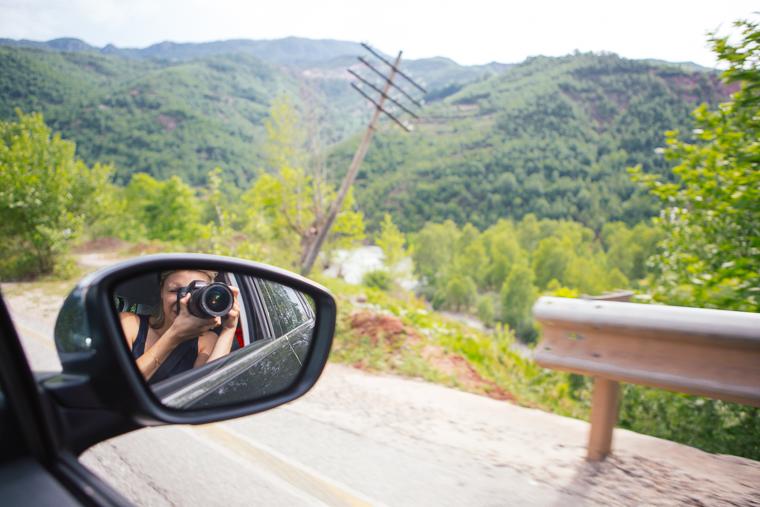 Taking photos out car window albania