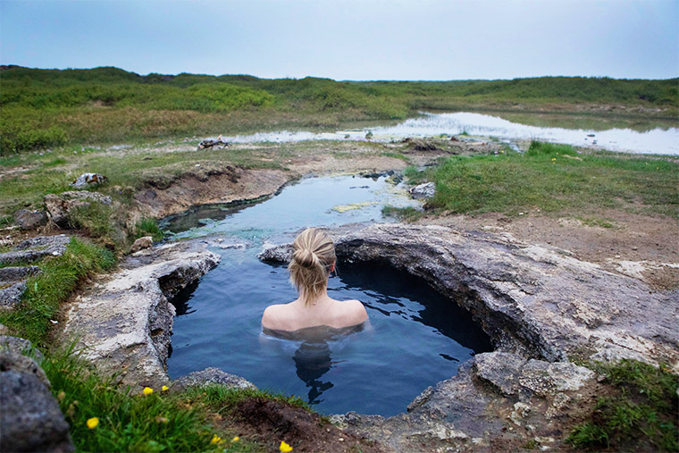 Taking a dip in the natural hot springs in northern iceland