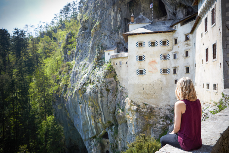 Sitting by Predjama Castle Slovenia