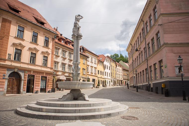 Colorful buildings architecture and fountain in ljubljana slovenia