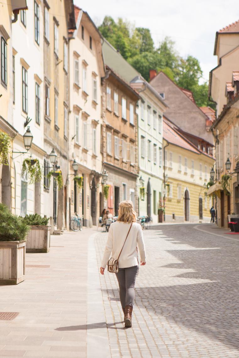 Walking past rows of pastel buildings downtown ljubljana slovenia