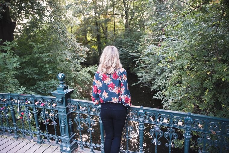 Wearing papercrown floral print top at the vondelpark in amsterdam