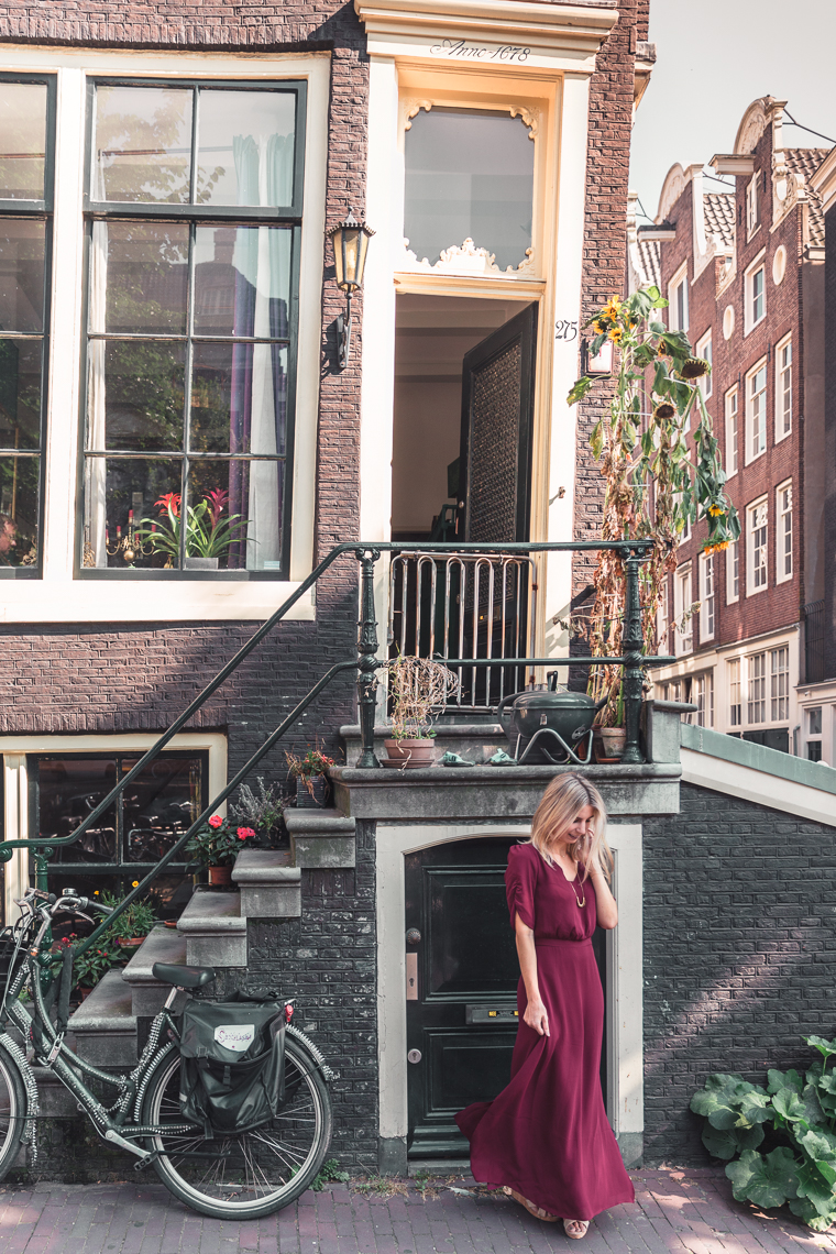 wearing papercrown dress in front of canal house amsterdam