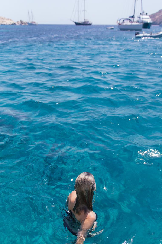 in the Mediterranean sea water by a boat mykonos