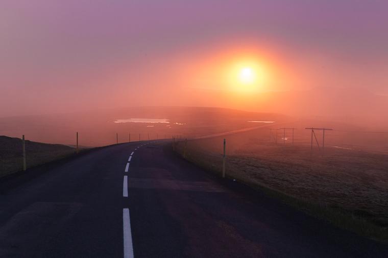 The midnight sun through haze in Iceland finduslost