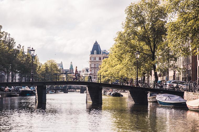 Amsterdam Canal Boat Ride Views of City Bridges Bikes