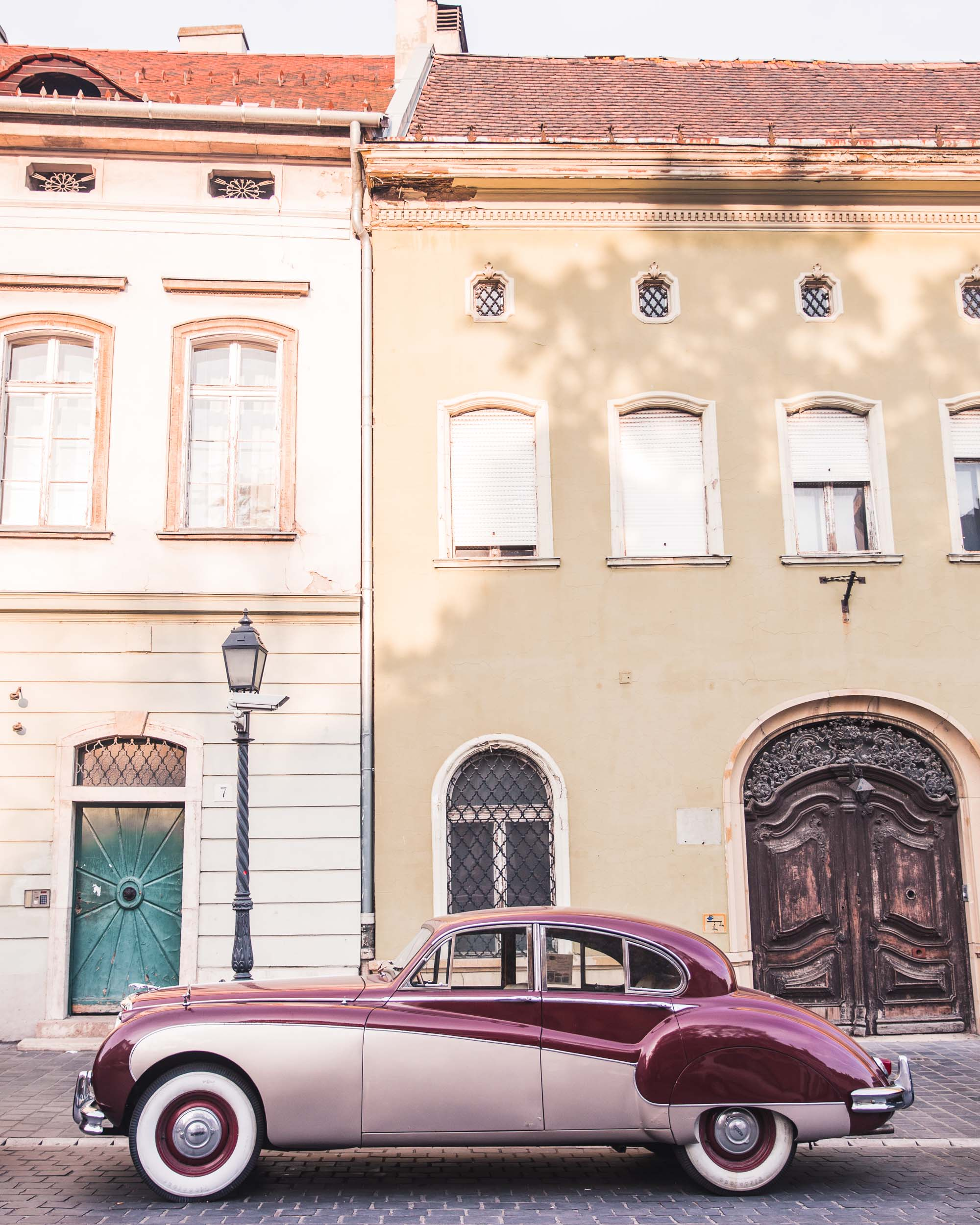 Vintage car in front of hungarian houses in Budapest Hungary