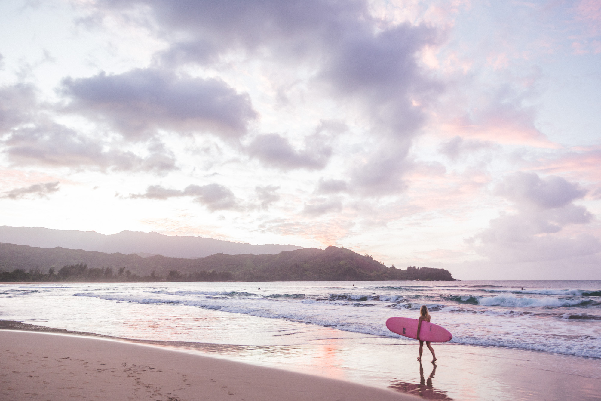 Surfing at Sunset Hanalei Bay Beach Hawaii Kauai Travel Guide via Find Us Lost