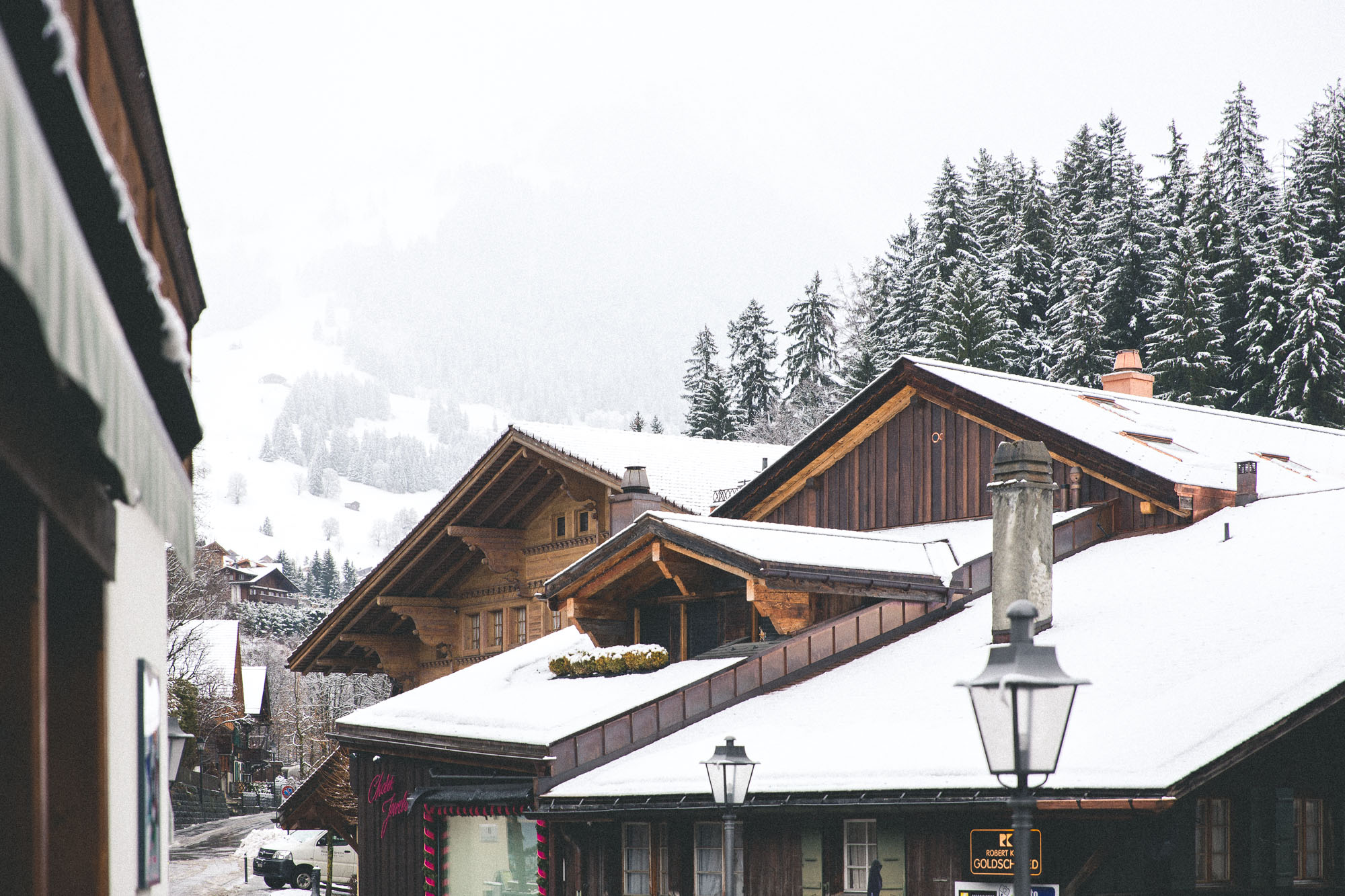 Snowy Rooftops downtown Gstaad Switzerland