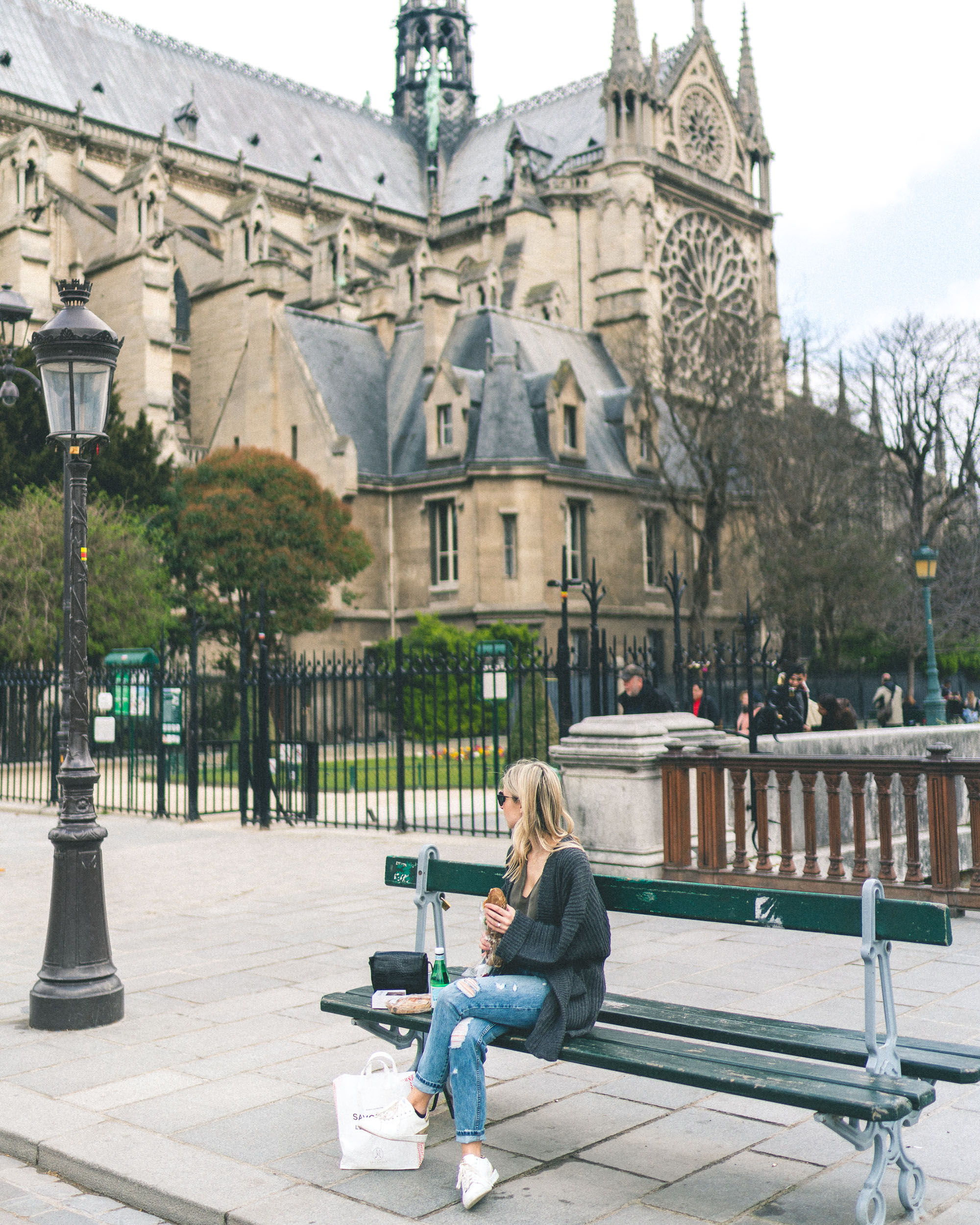 Best parisian bakeries to go - Notre Dame de Paris bench - Complete Paris Travel Guide