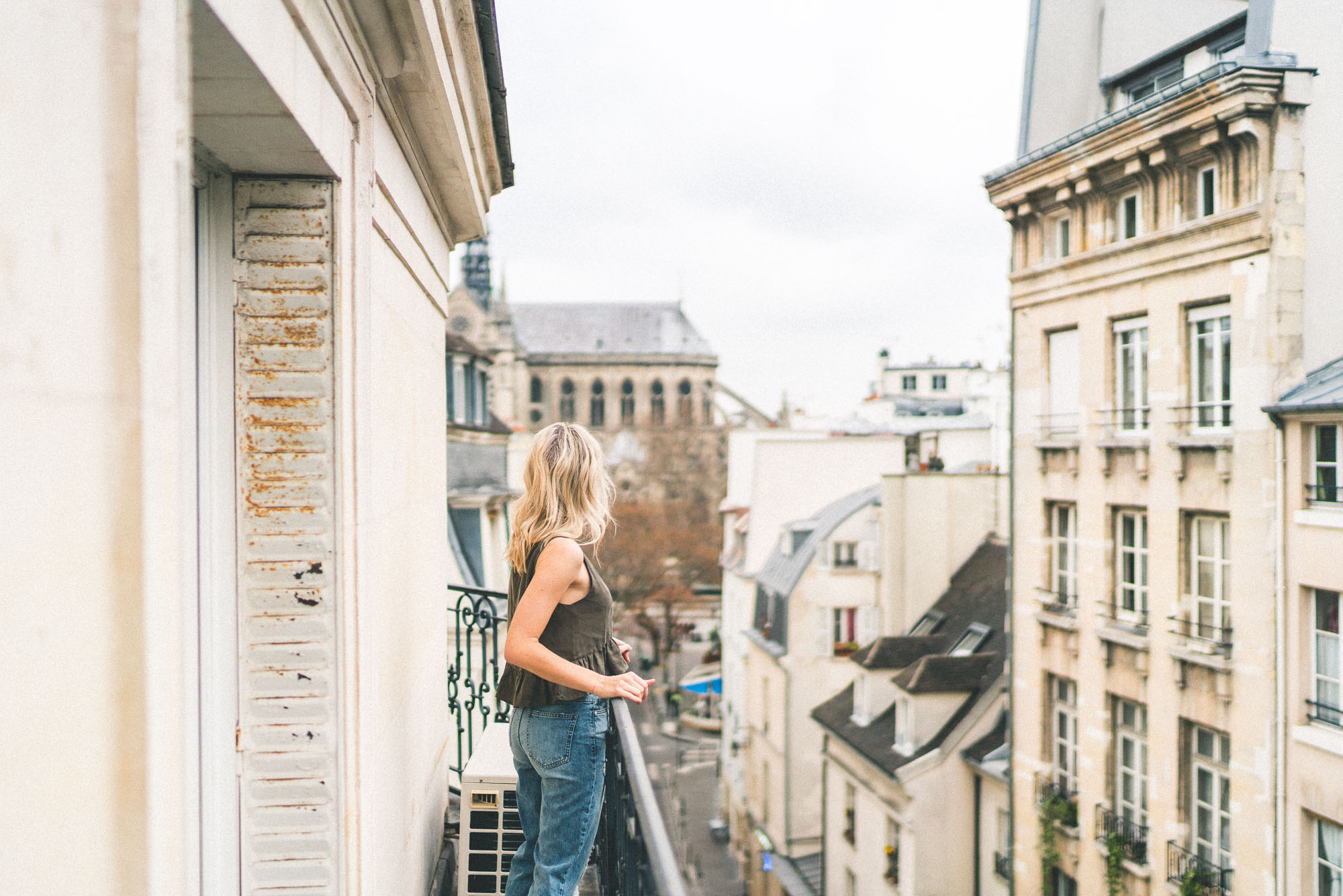 parisian balconies in paris overlooking french rooftops