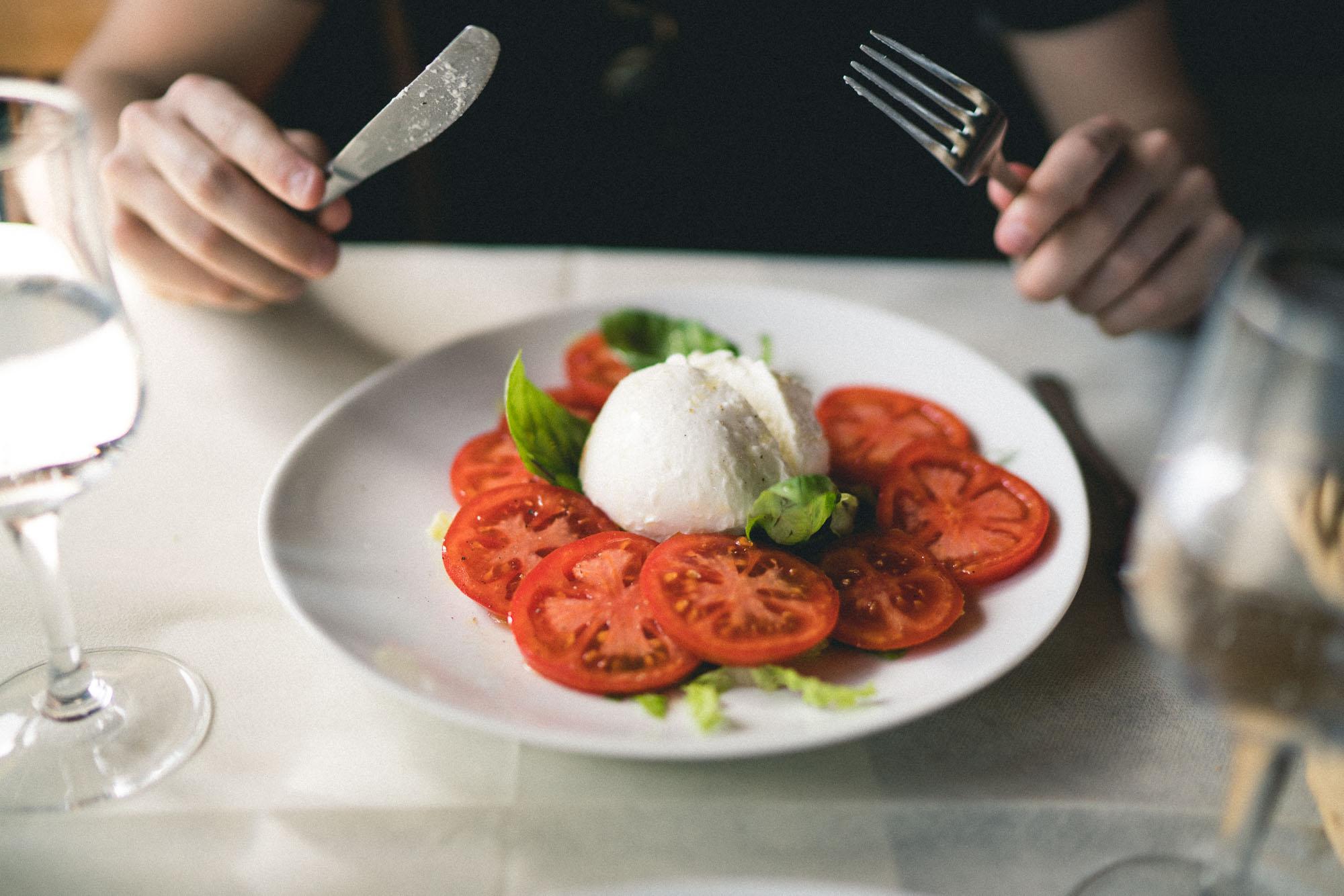 Fresh buffalo mozzarella and tomatoes in southern Tuscany, Italy