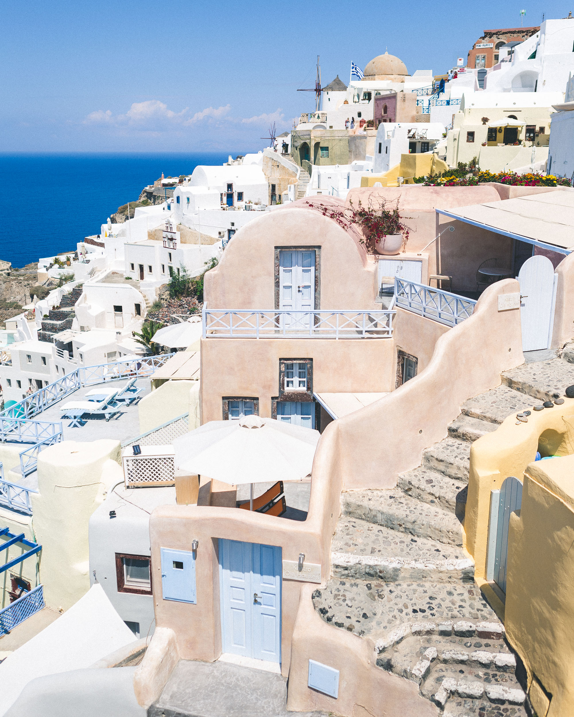 Pink, white and blue buildings of oia, santorini, greece