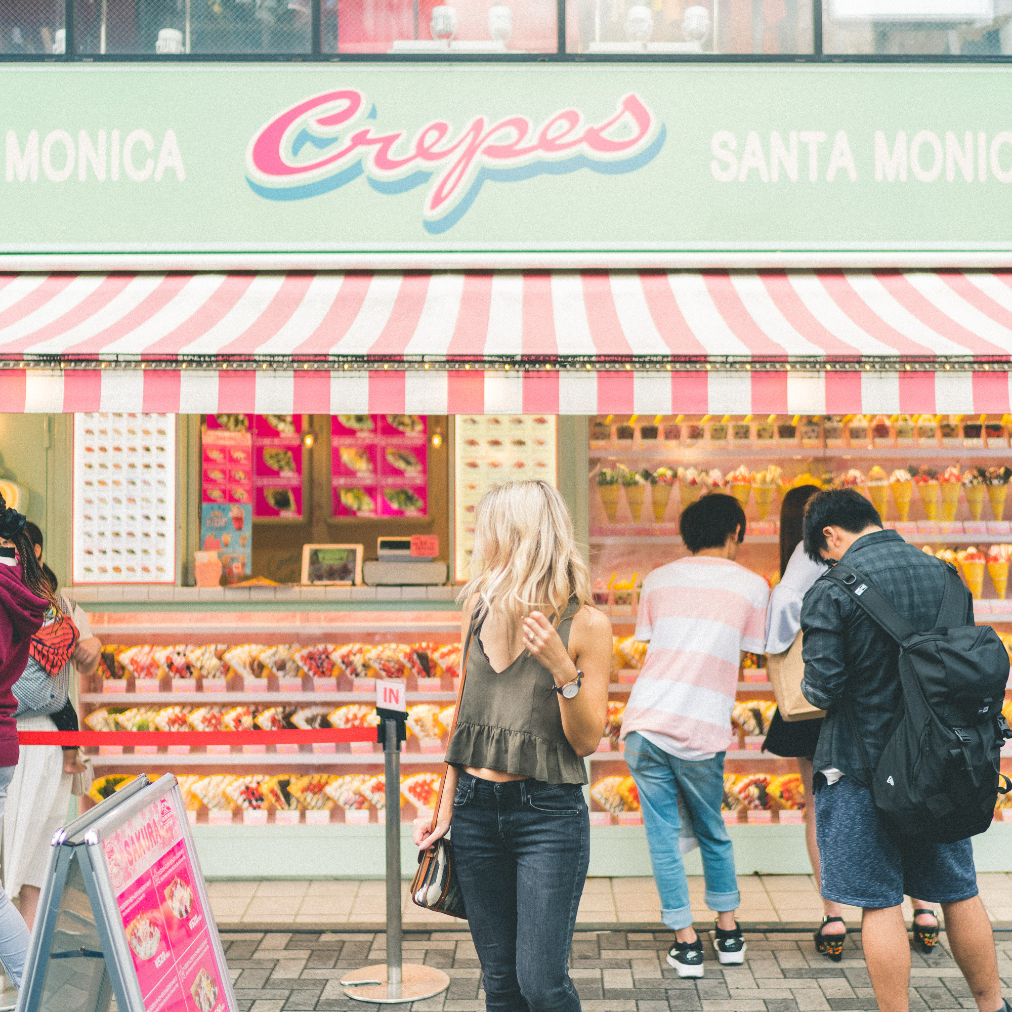 The Complete Tokyo Travel Guide   City Guides   Japan Travel Itinerary   Crepes Shop Harujuku Takeshita Street   Neighborhood Travel Tips