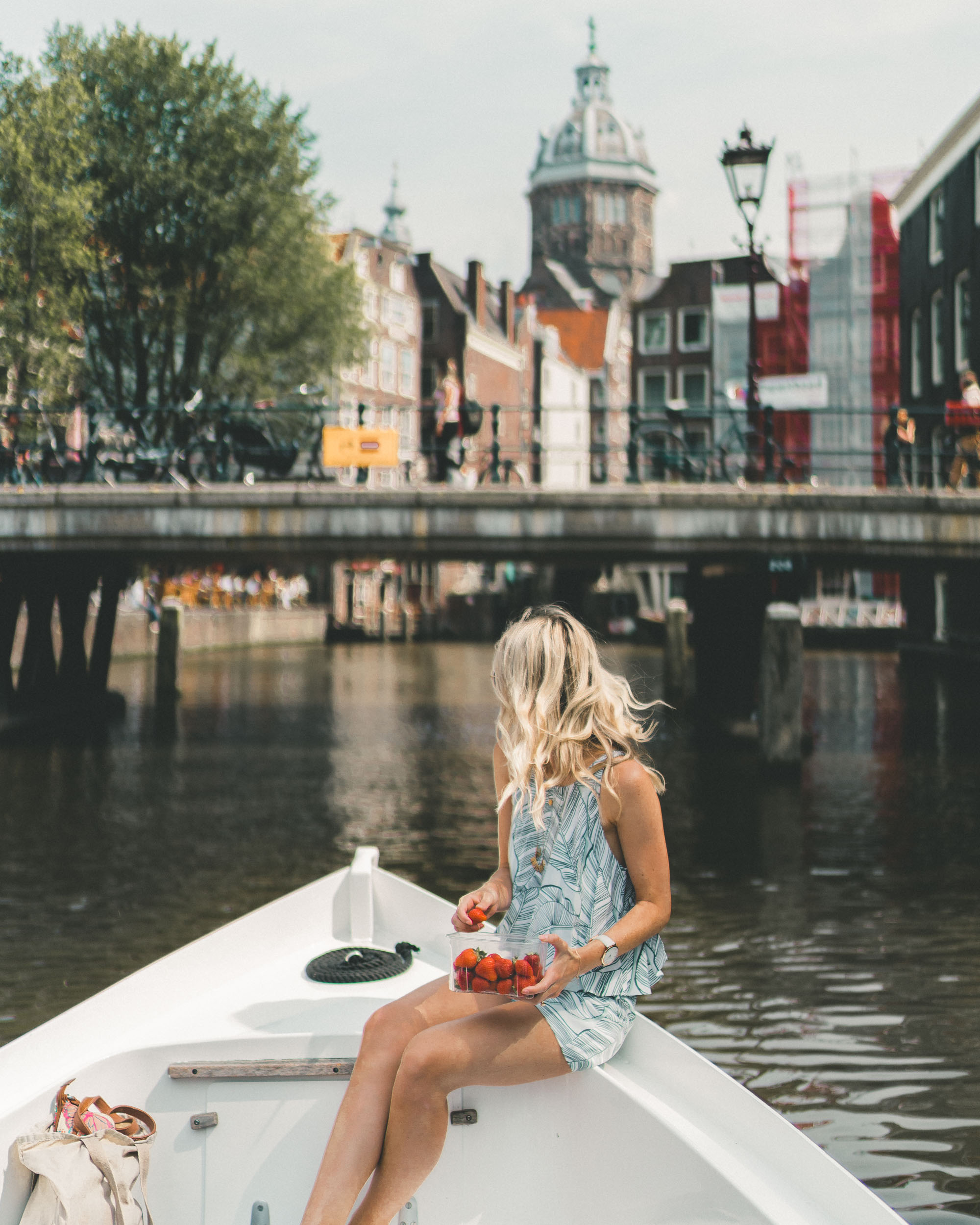 Boating on Amsterdam's canals in summer, The Netherlands