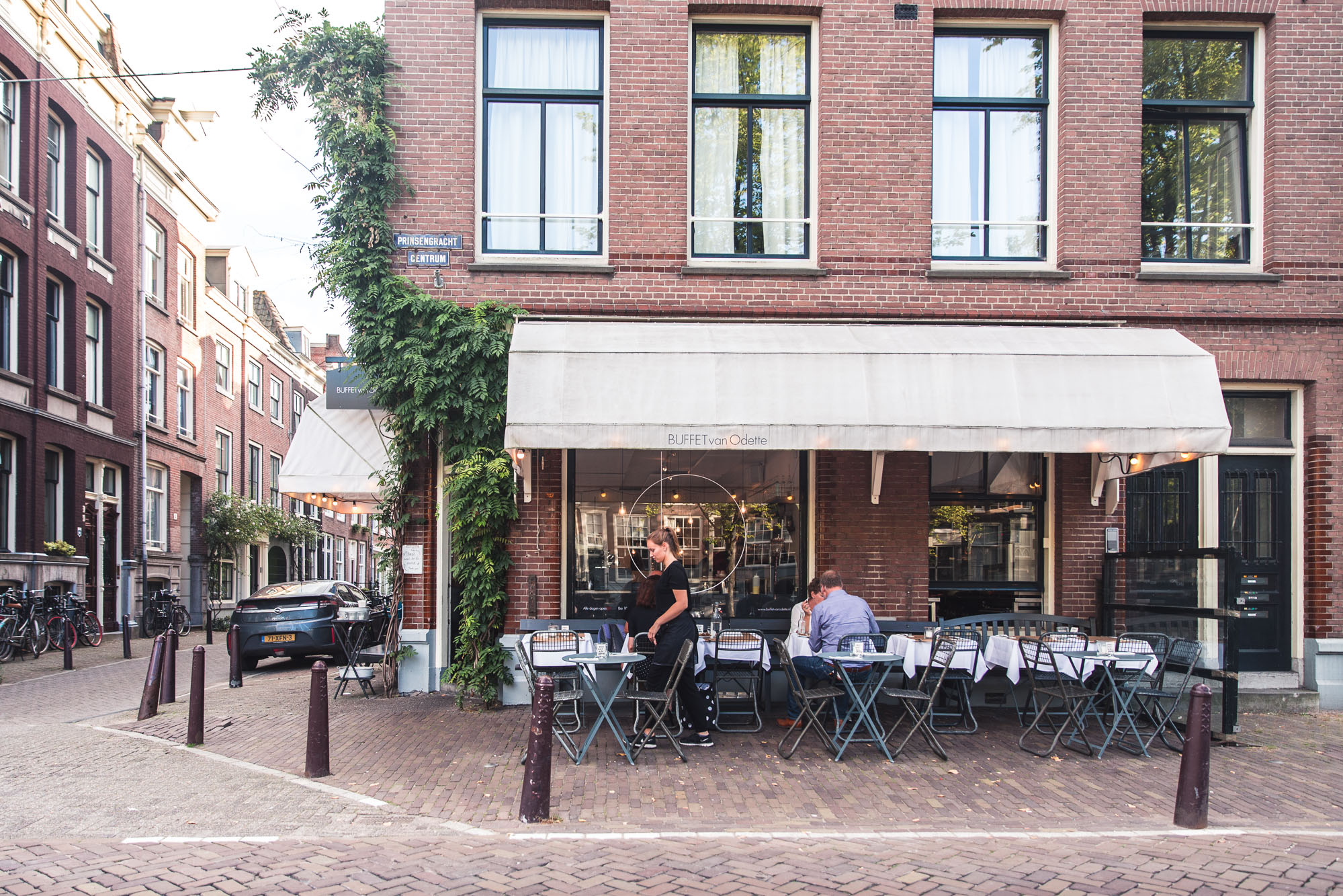Outdoor patio on the canals at Buffet Van Odette on the prinsengracht in Amsterdam, Holland, The Netherlands