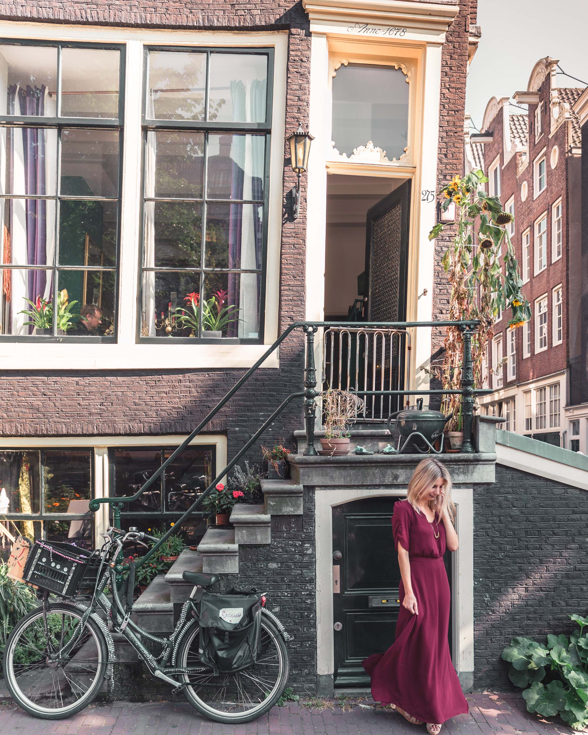 Crooked dutch canal house in Amsterdam, The Netherlands