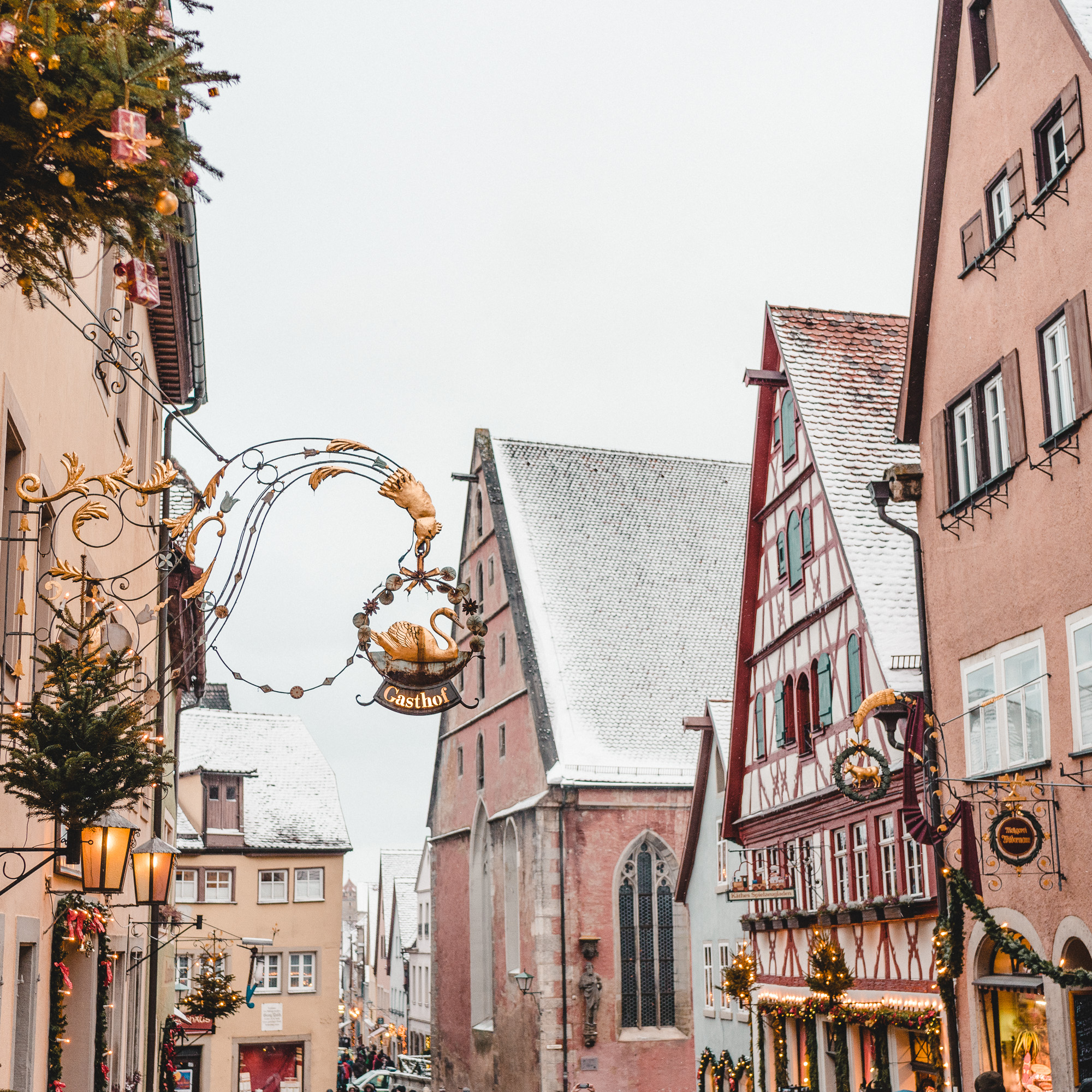 Snow covered rooftops in the pastel town of rothenburg ob der tauber germany christmas time