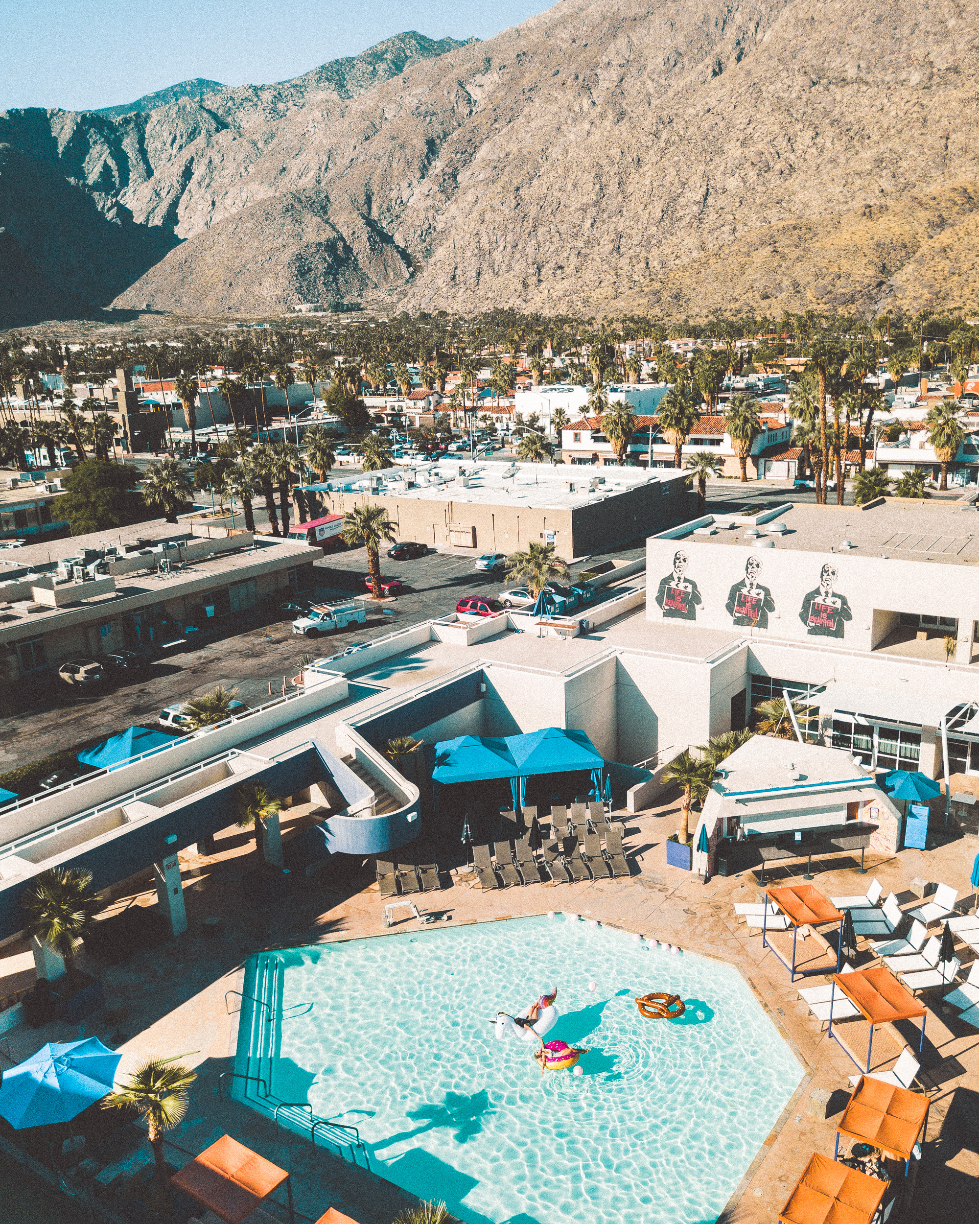 birds eye view of pool time floaties in palm springs california