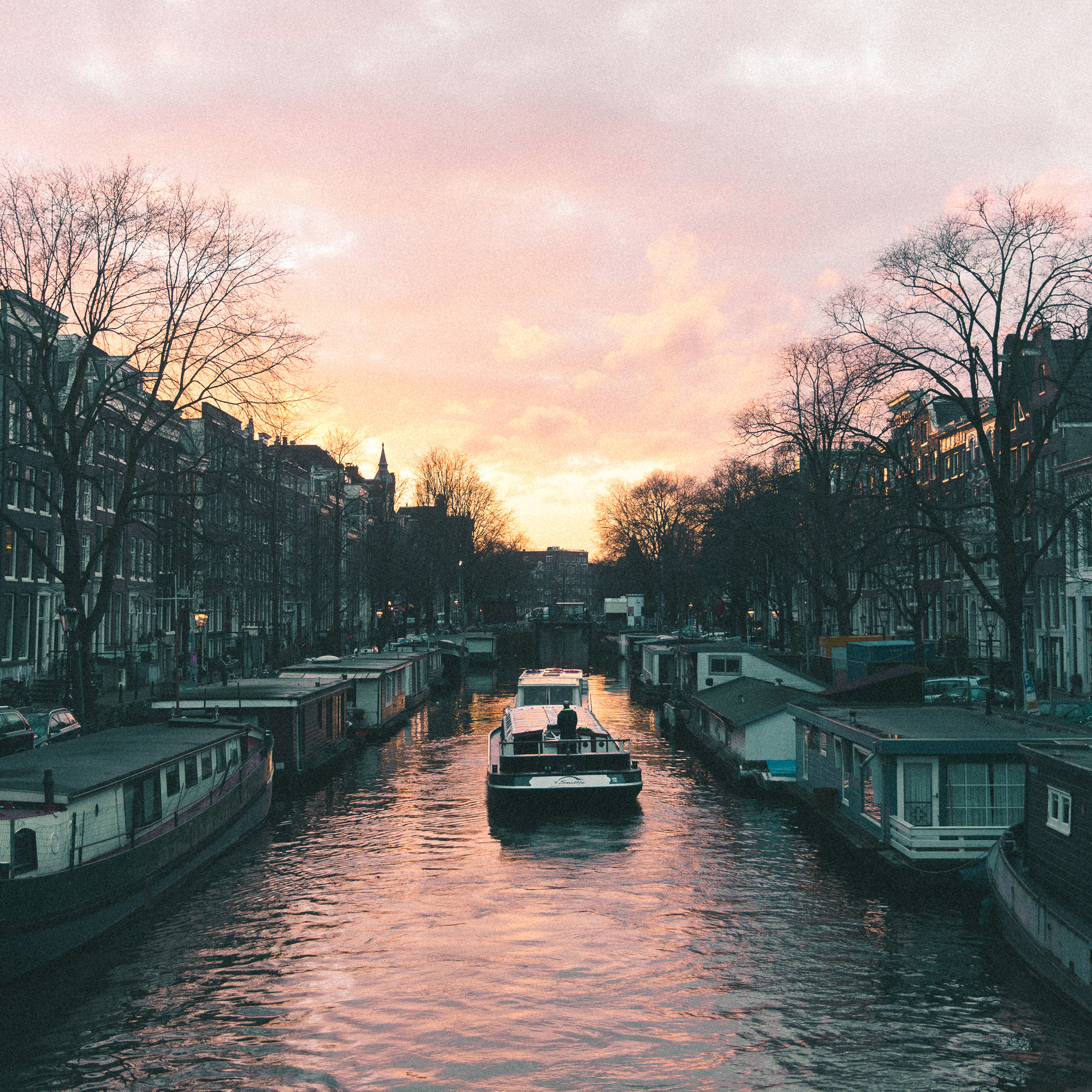 boating amsterdam's canals at sunset