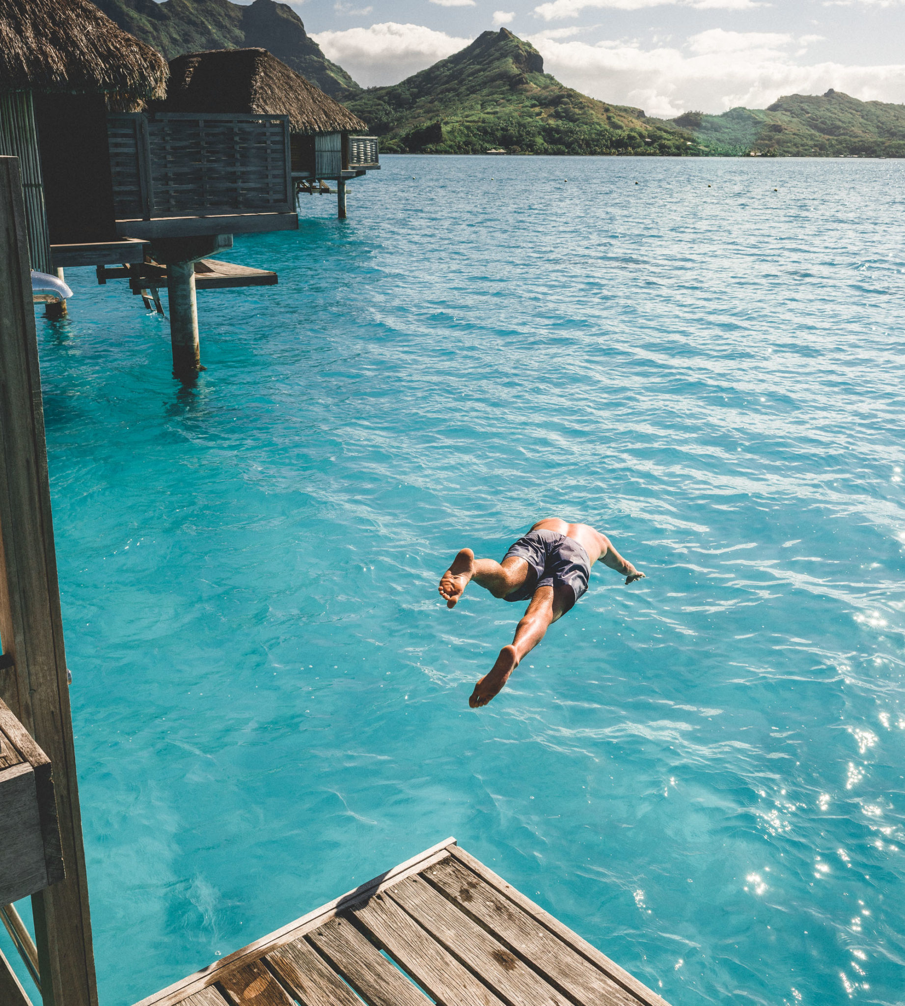 Overwater bungalow jump at four seasons bora bora in Tahiti for our honeymoon