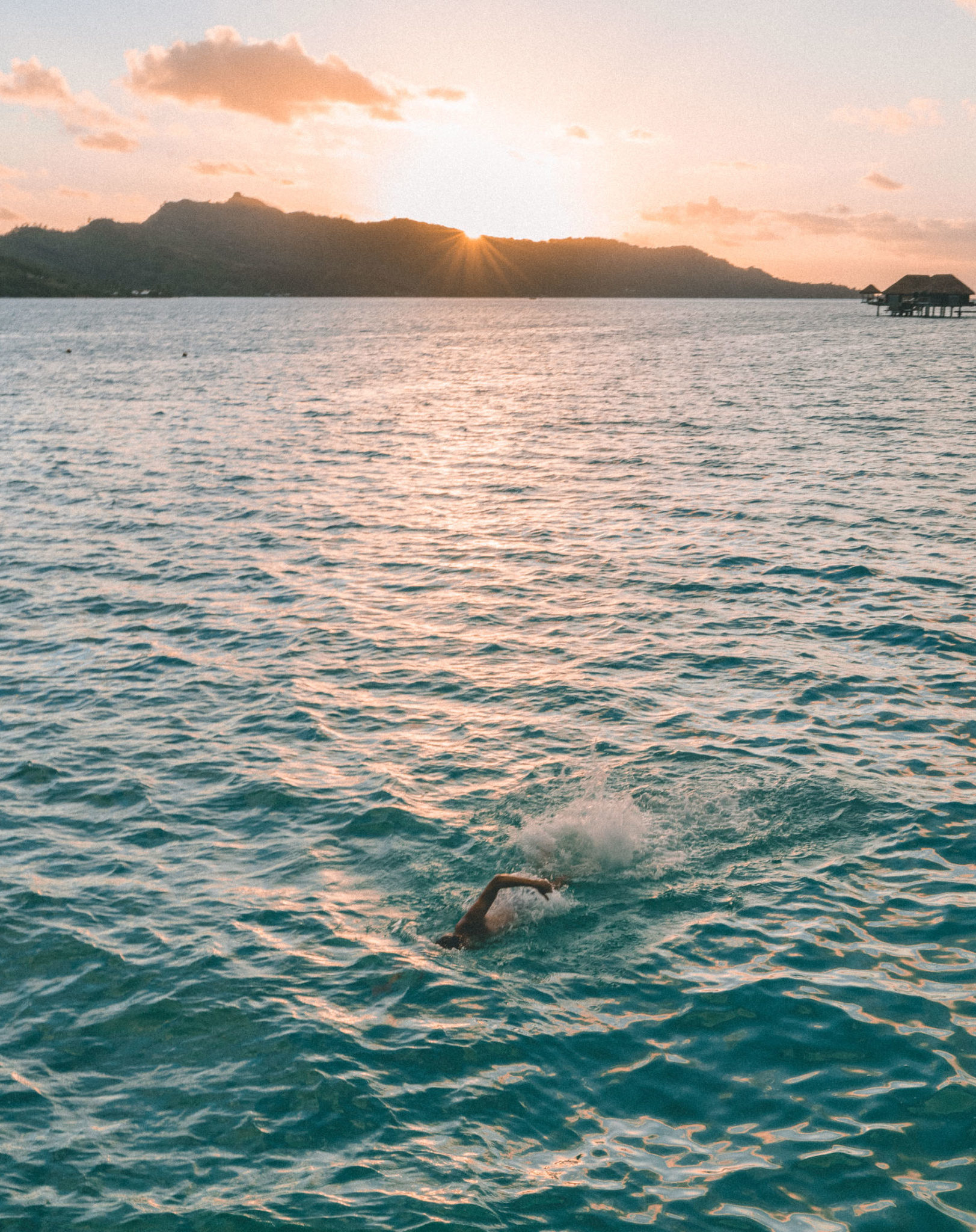 Swimming at sunset from our overwater bungalow at Four Seasons Bora Bora for our honeymoon via @finduslost
