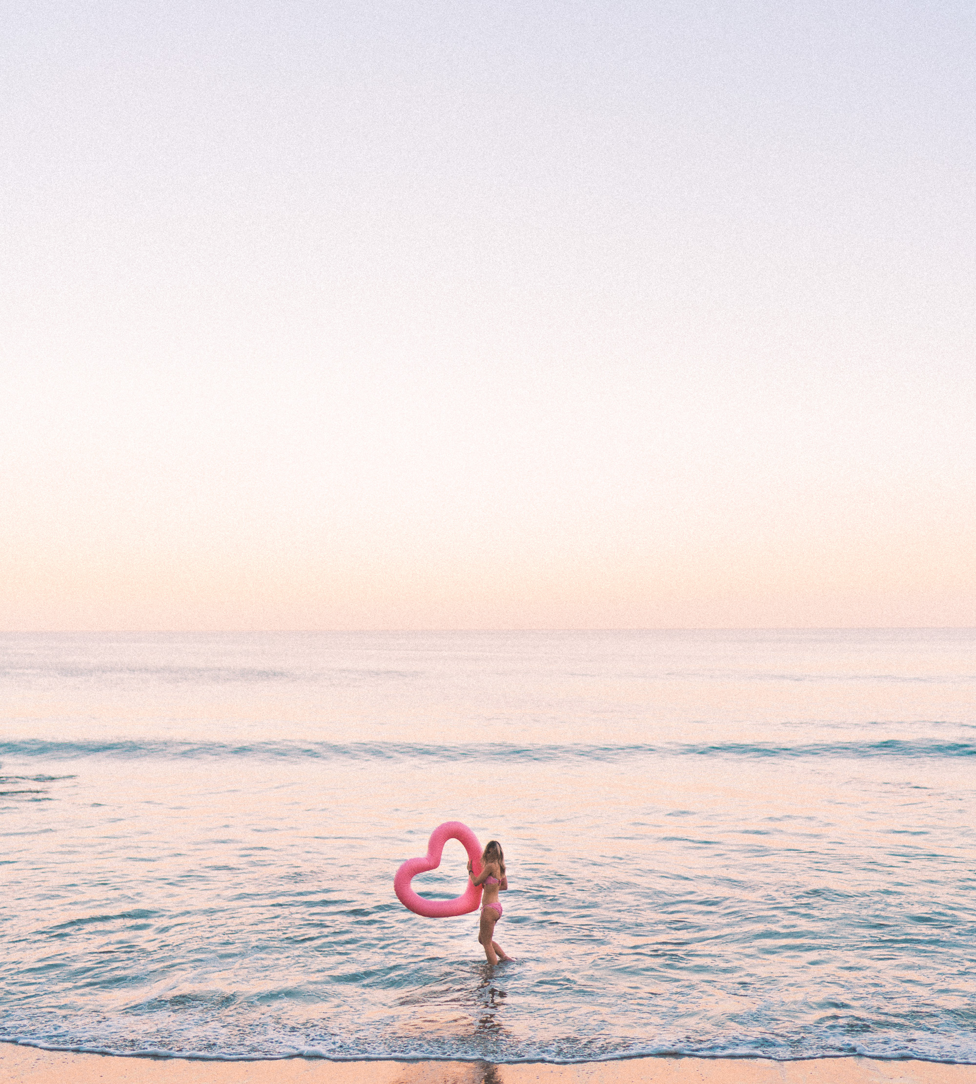 swimming in malibu with pink heart floatie
