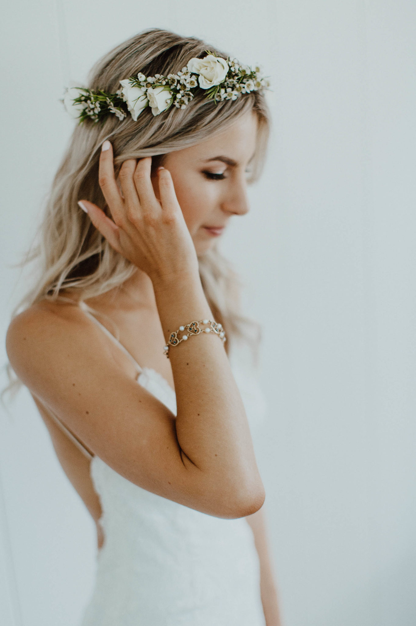 white lace wedding dress blush flowers white flower crown