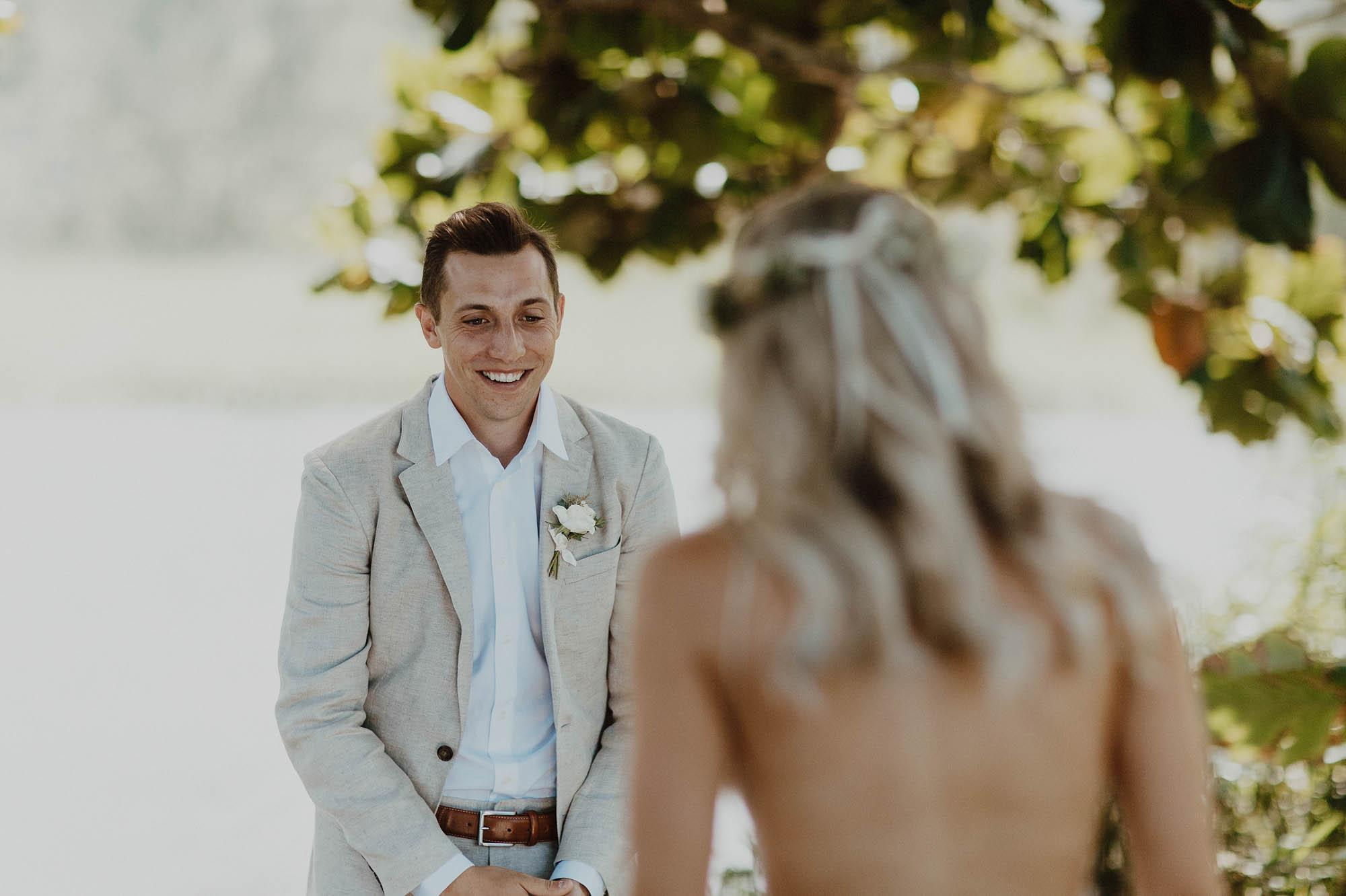 First look photos white backless lace wedding dress hanalei north shore kauai hawaii