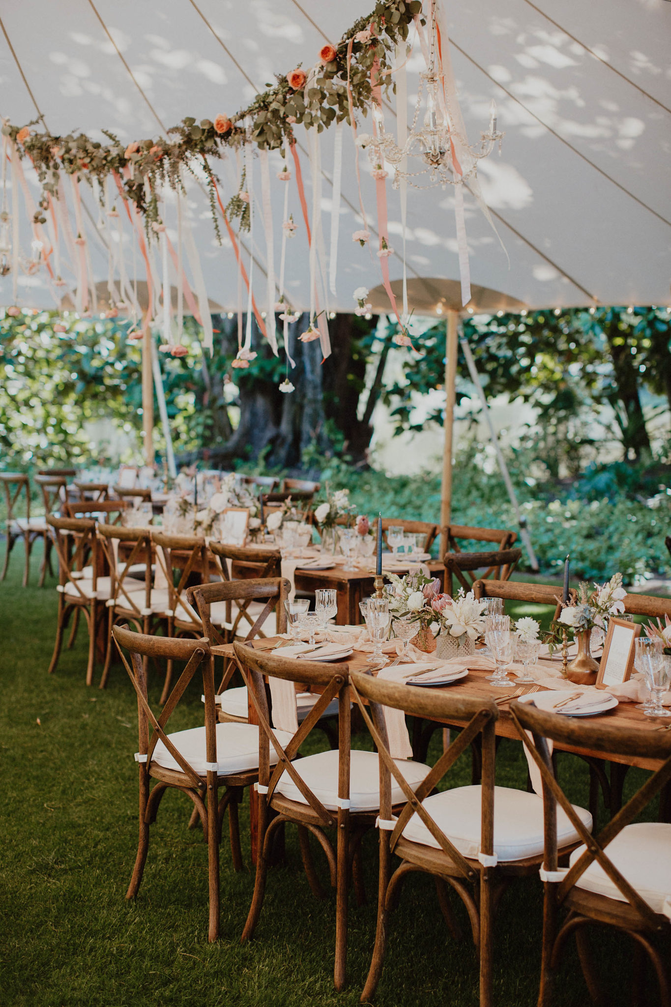 Blush and gold table setting place settings hanging flowers floral tent