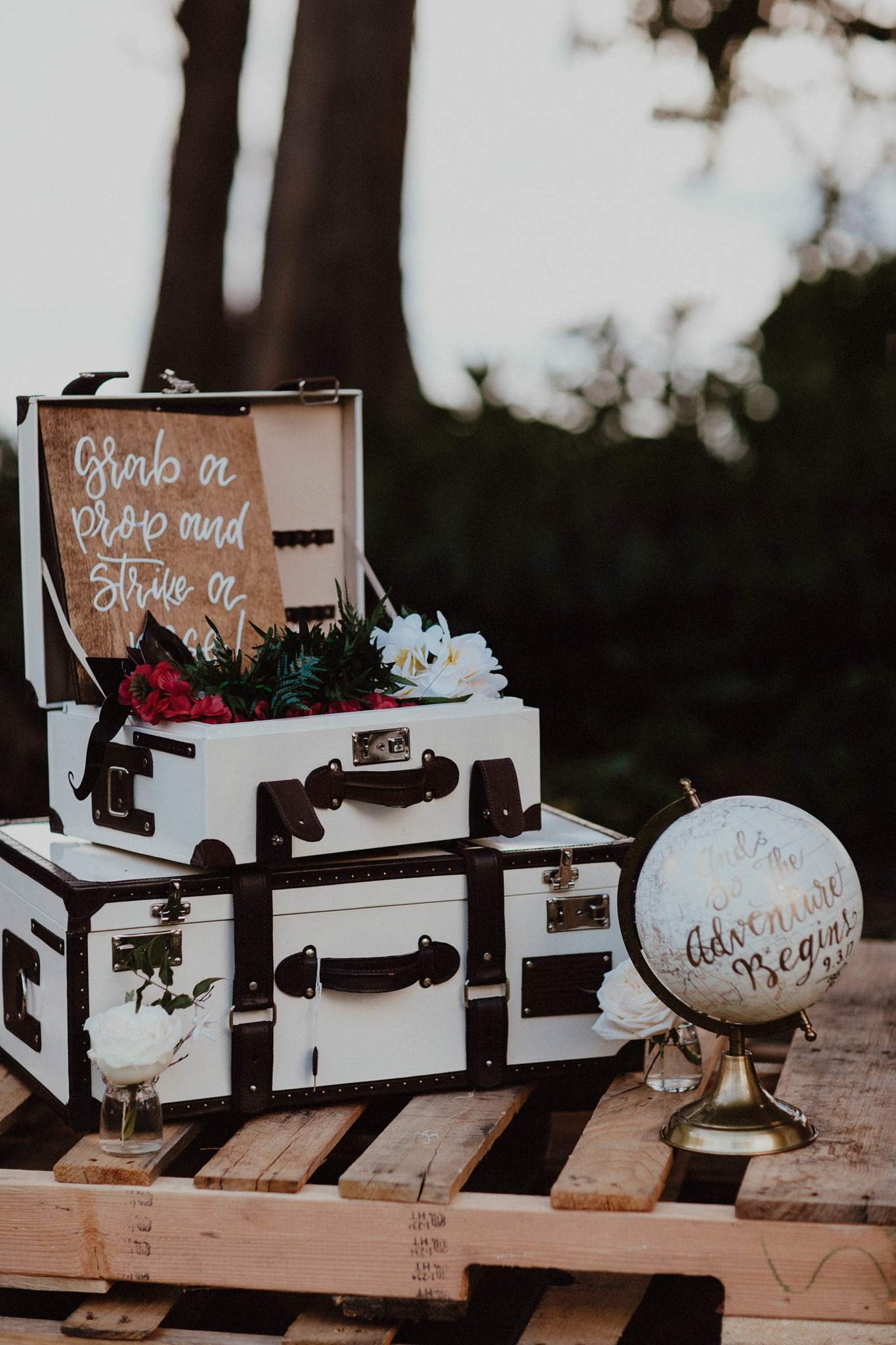 Suitcases for travel themed wedding photo booth kauai hawaii