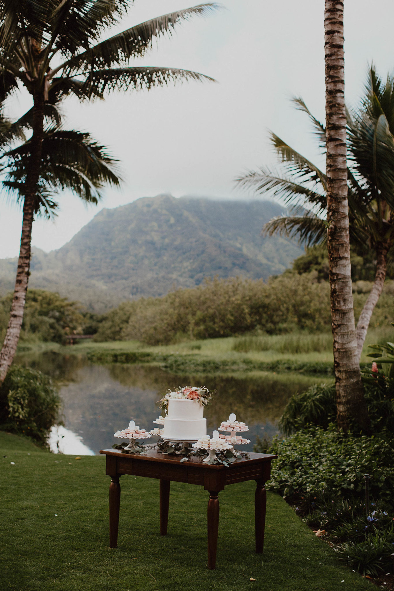 Dessert table blush and white floral cake with french macarons for wedding on north shore kauai hawaiii