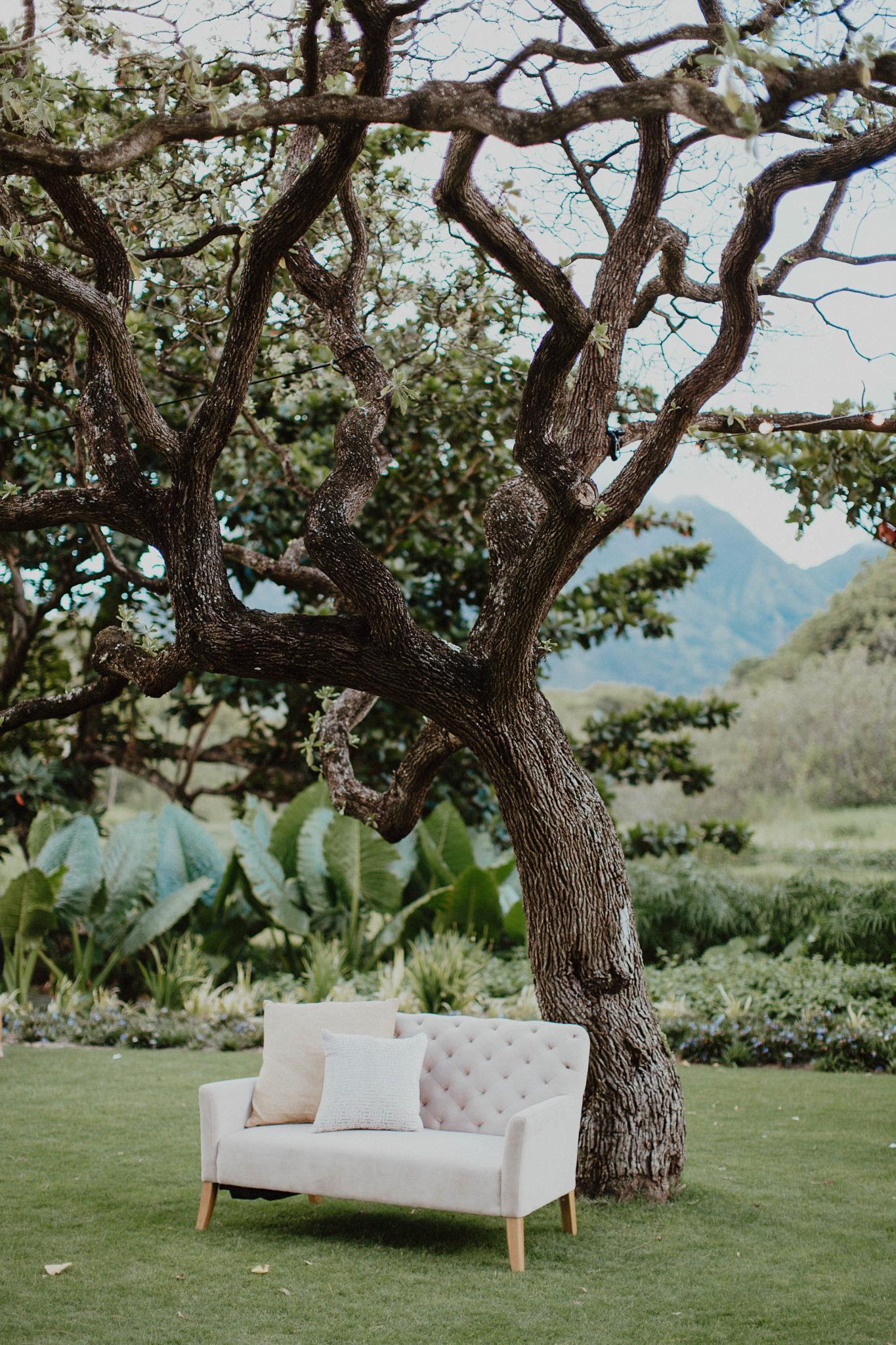 Blush couches on destination wedding in kauai