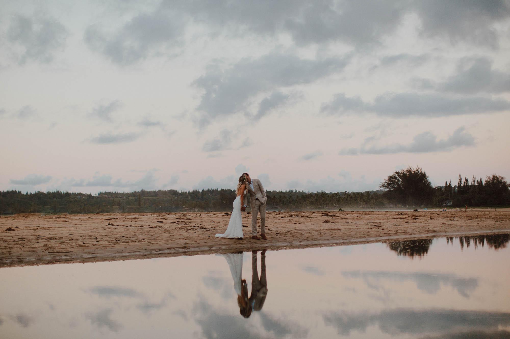 Wedding photos on hanalei bay beach at sunset north shore kauai hawaii