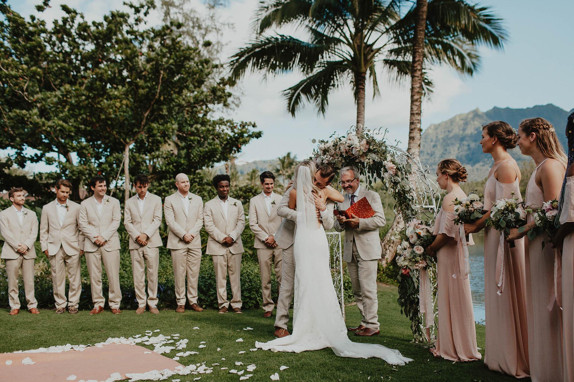 Saying vows under arch our destination kauai wedding