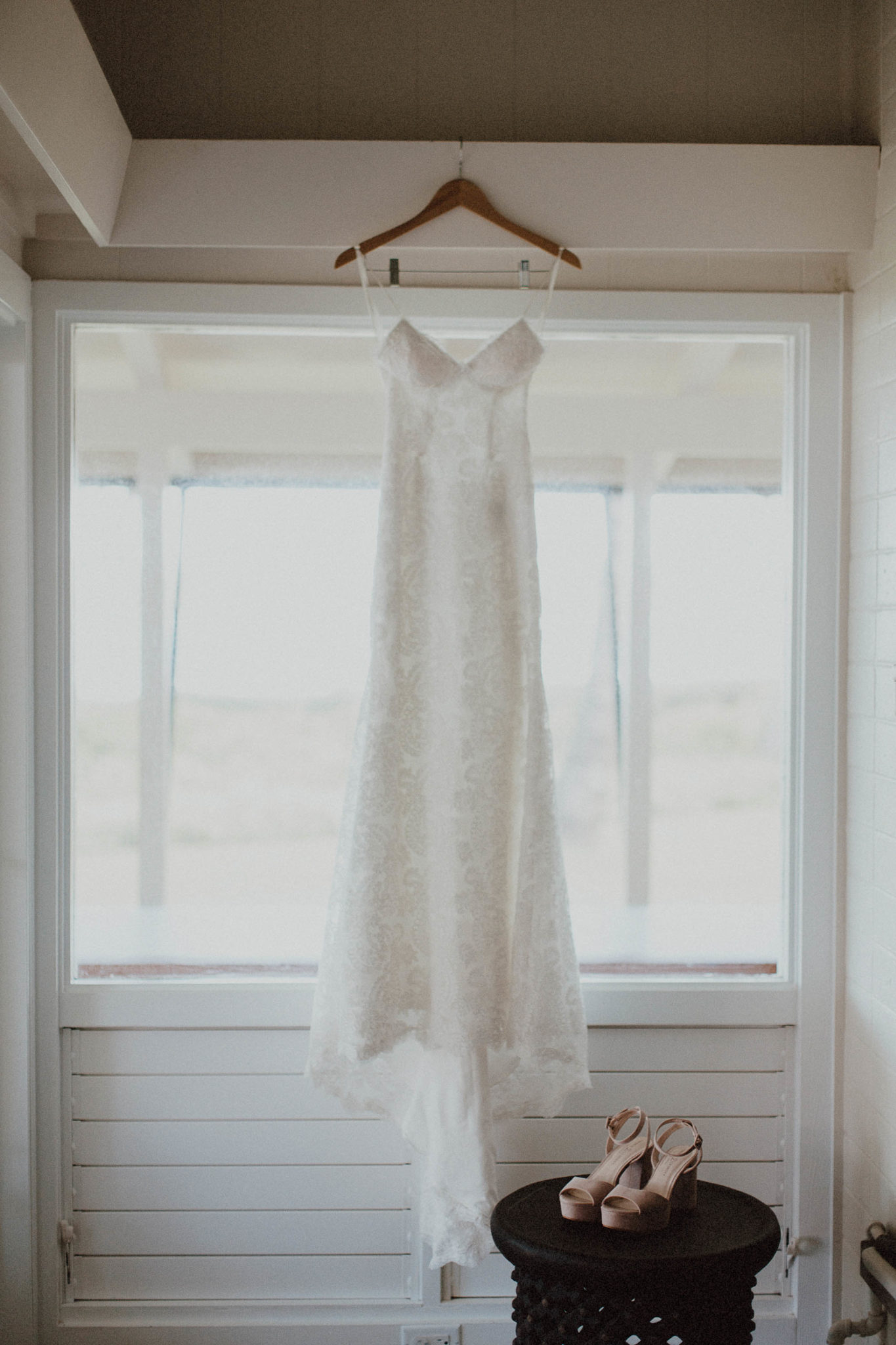 White lace dress for tropical dream wedding and blush shoes