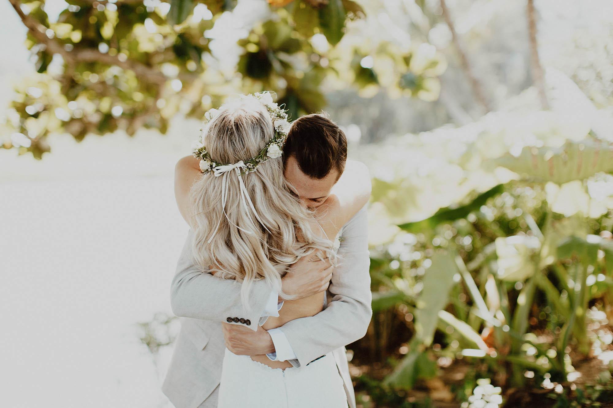 Wedding photos in paradise backless dress hanalei north shore kauai hawaii