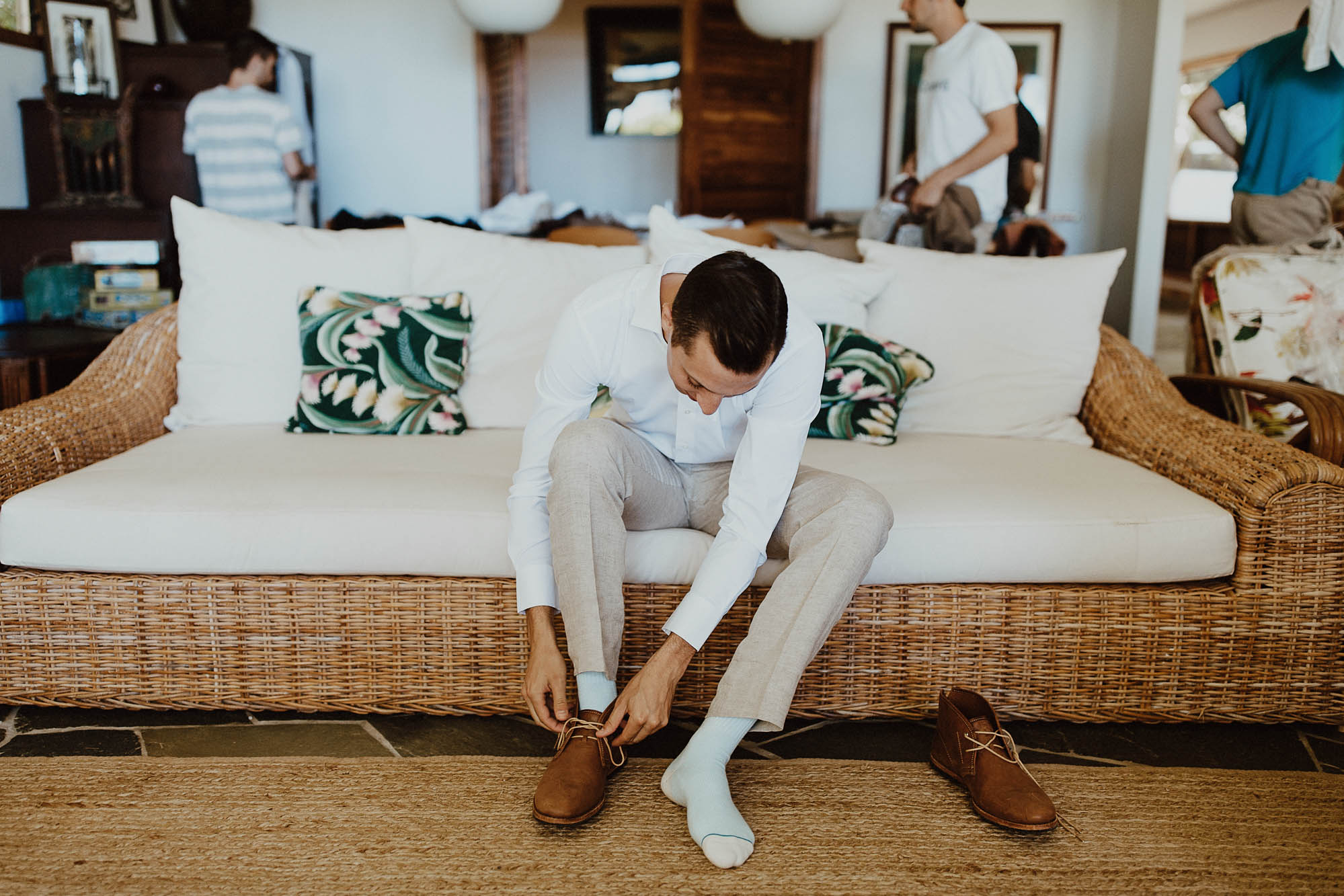 Groom putting on his shoes kauai hawaii north shore