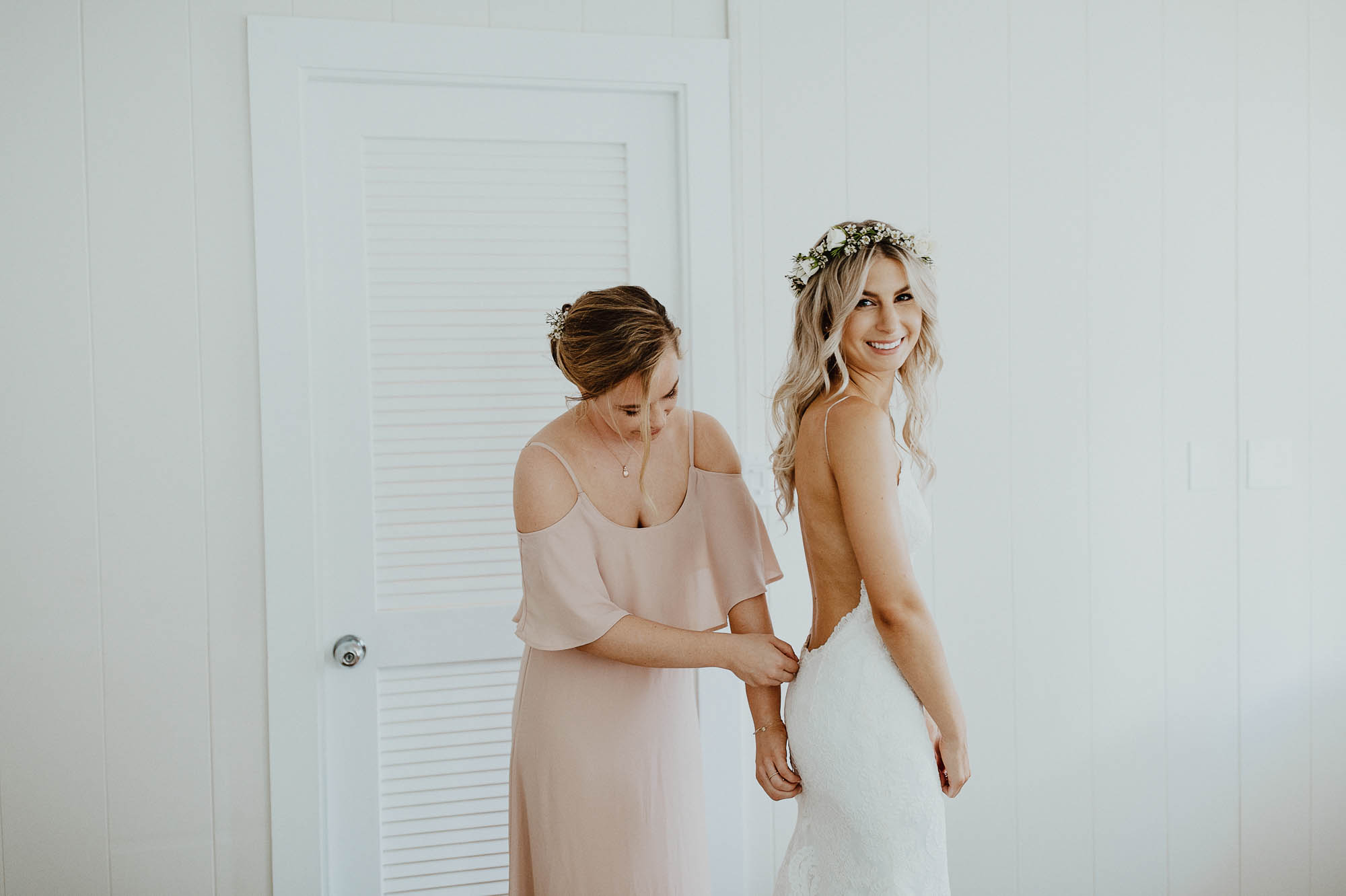 Zipping up white lace backless wedding dress with my maid of honor