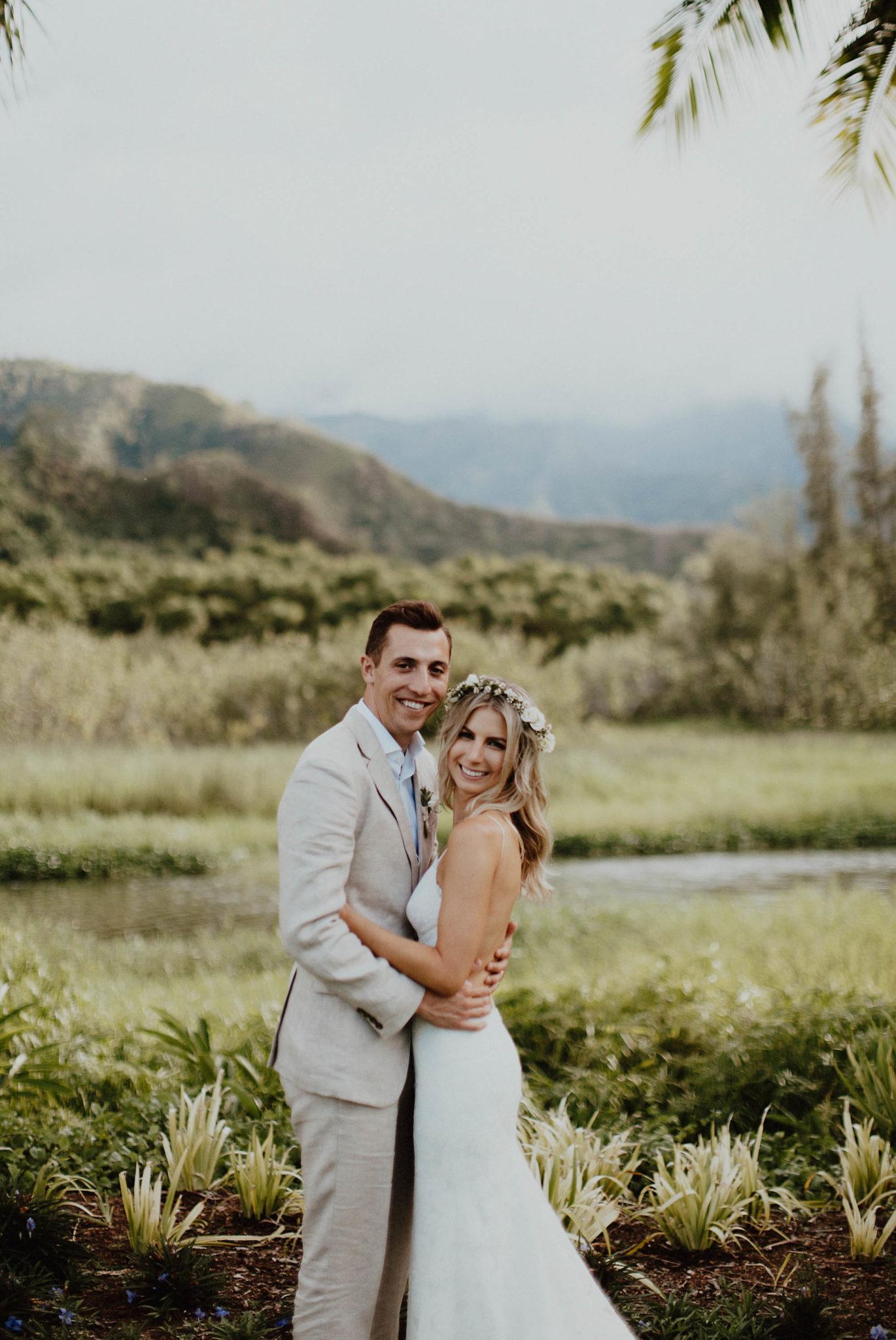 Wedding photos in paradise backless lace dress hanalei north shore kauai hawaii