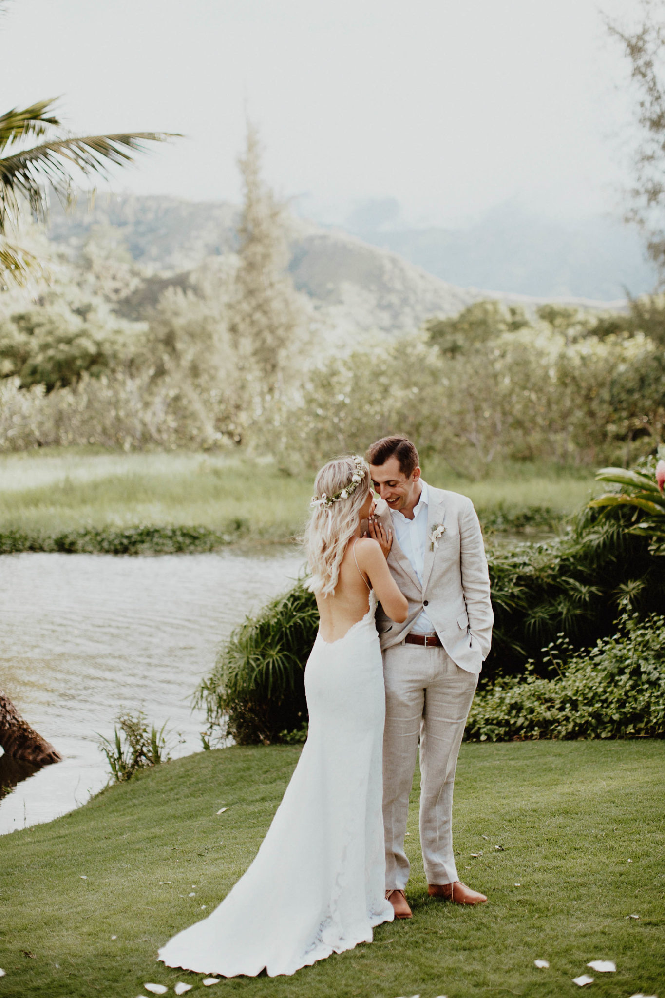 Wedding photos with backless white lace wedding dress and flower crown