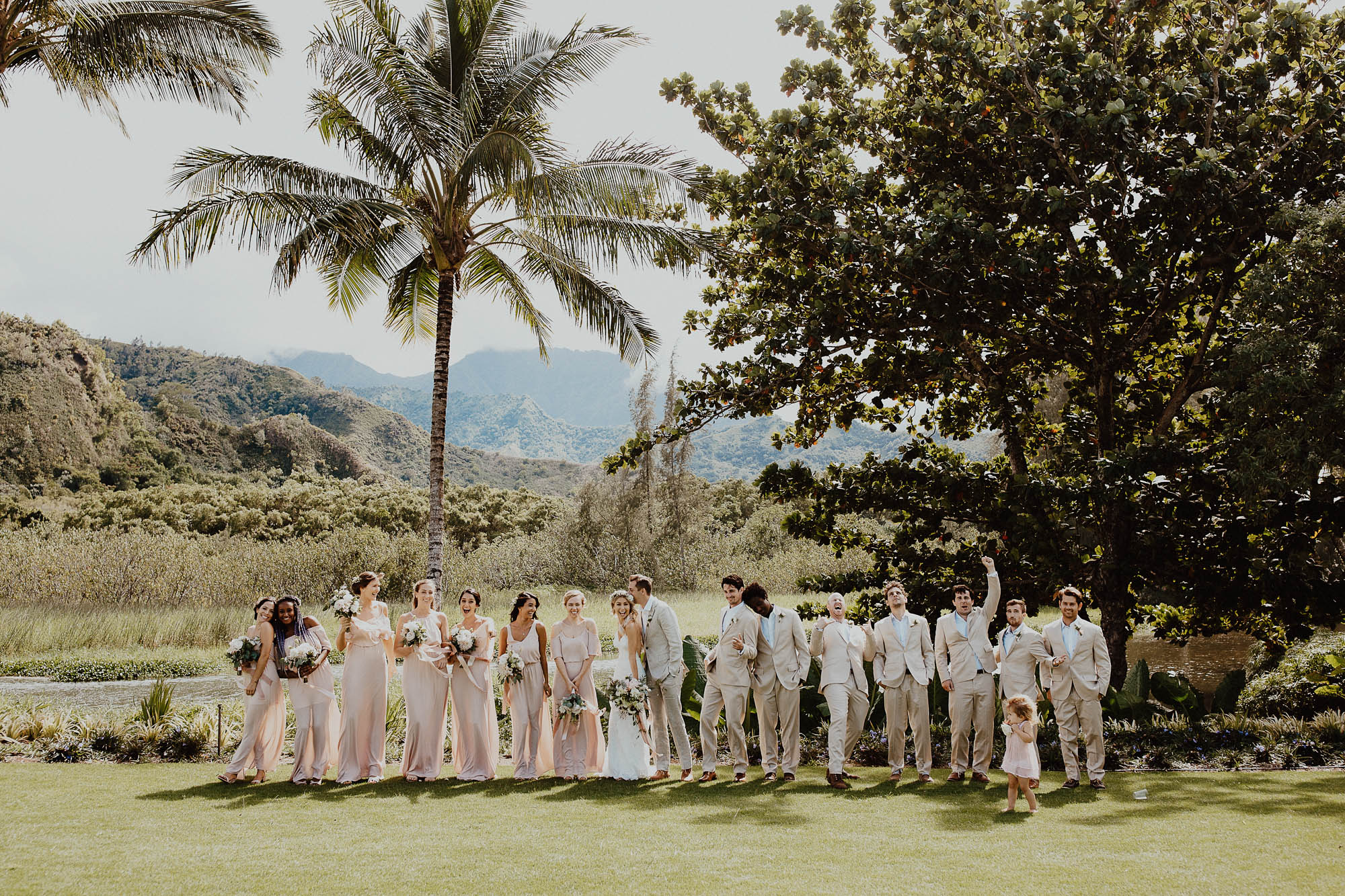 Our wedding party blush dresses and grey suits in north shore kauai hawaii wedding