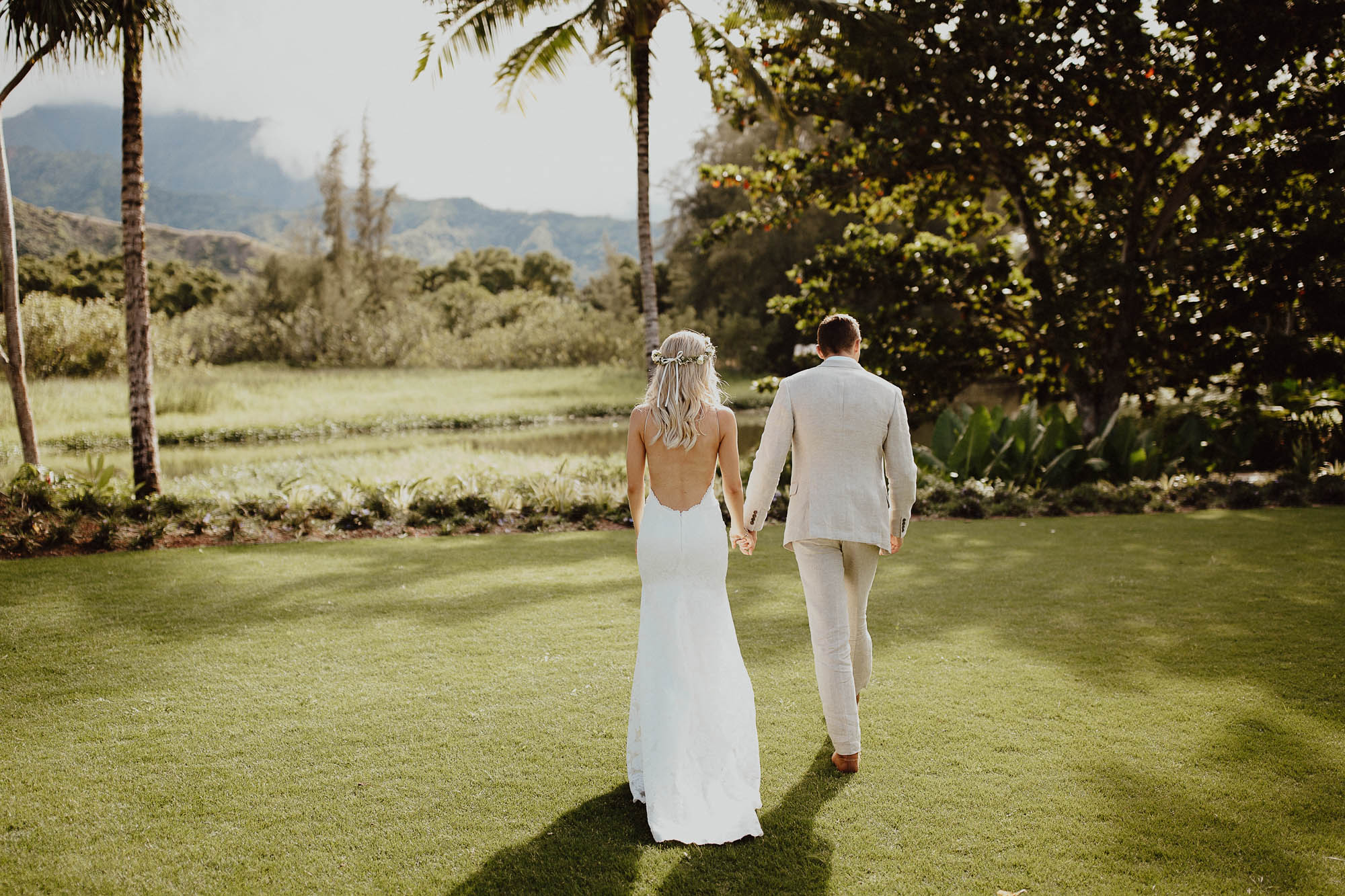 Couple photos backless wedding dress on hanalei north shore kauai hawaii