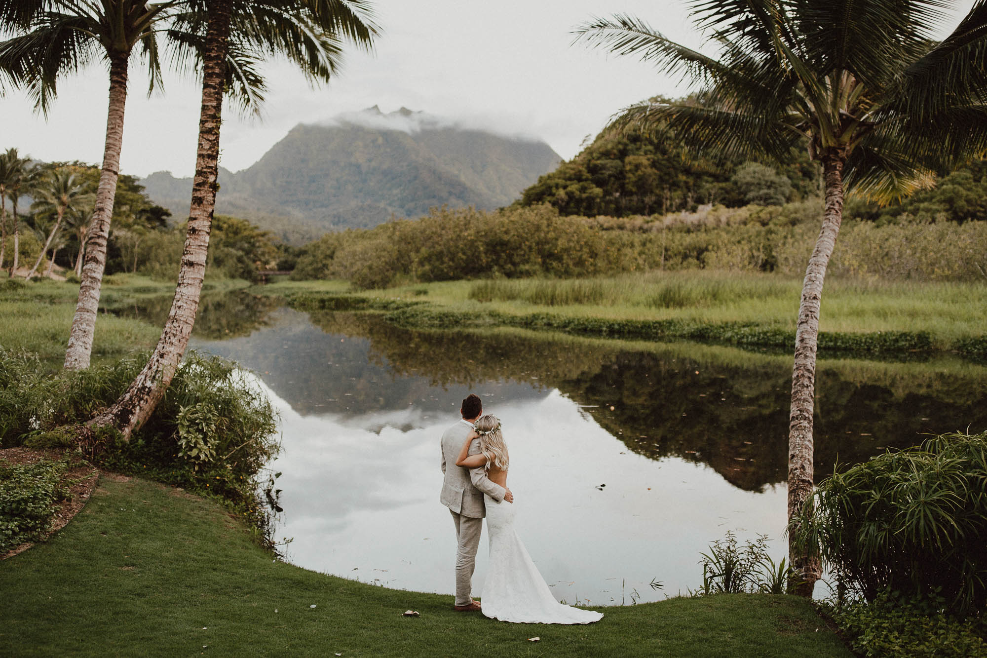 Wedding photos in paradise backless dress hanalei north shore kauai hawaii