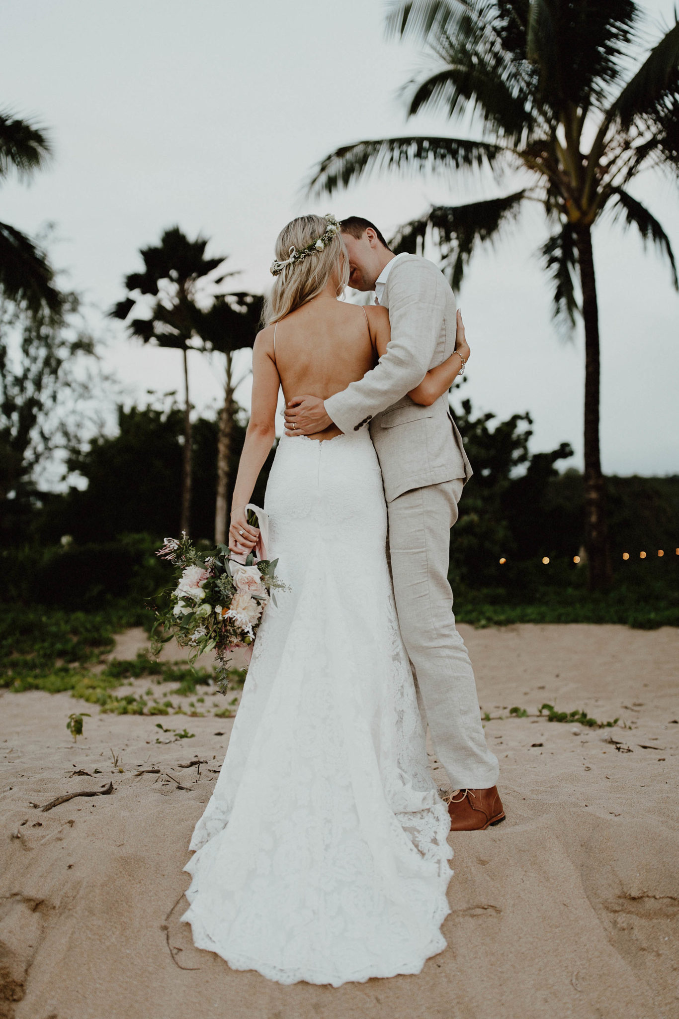 Couple photos backless wedding dress on hanalei bay beach north shore kauai hawaii