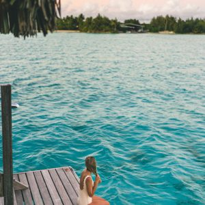 Swimming at sunset at Four Seasons Resort Bora Bora in Tahiti via @finduslost